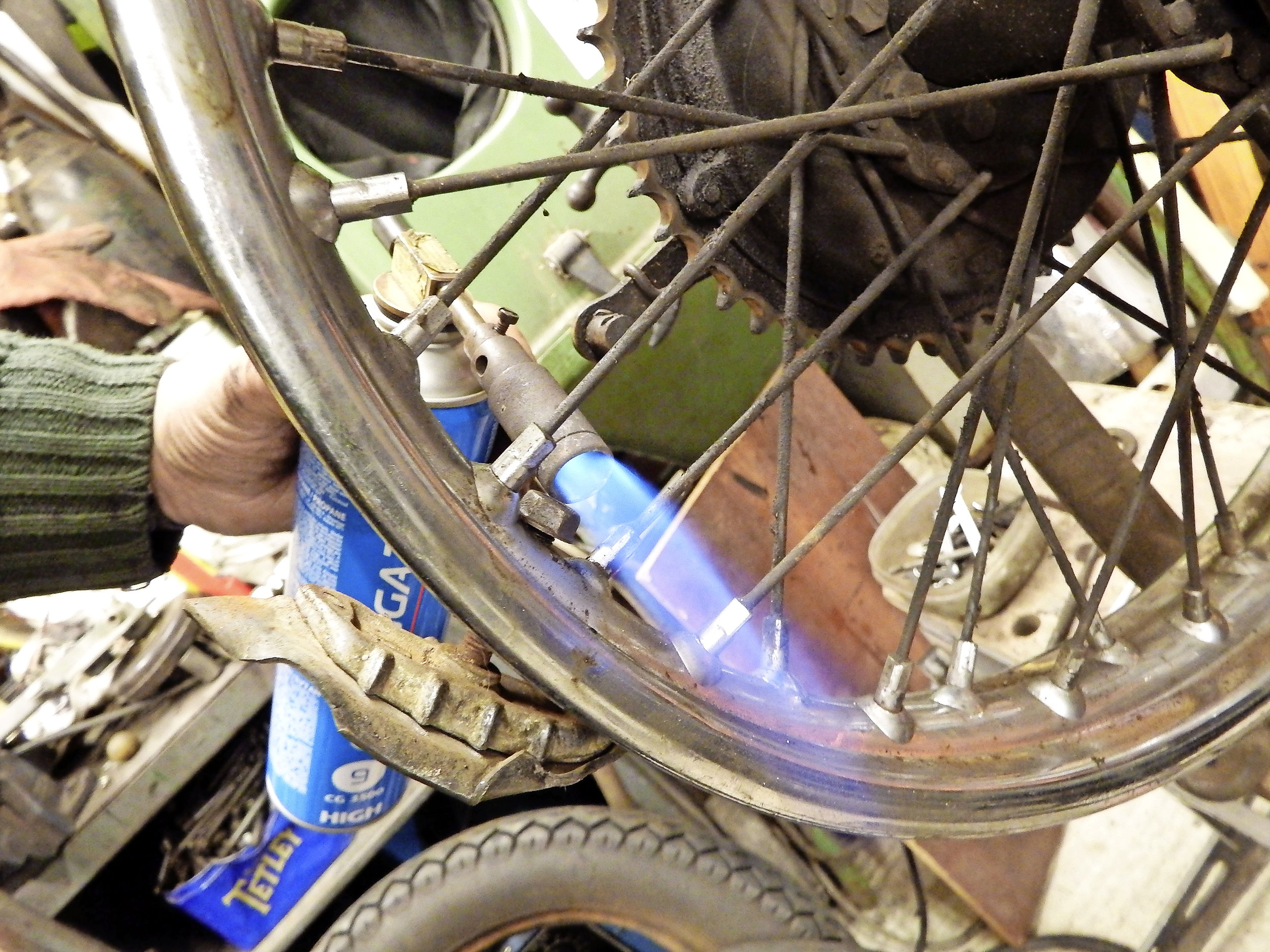2.  Tightening may cause the sharp spoke end to poke out of the nipple, so remove the tyre. If nipple won't move freely don't force it – breakage is a much bigger problem. Use heat.