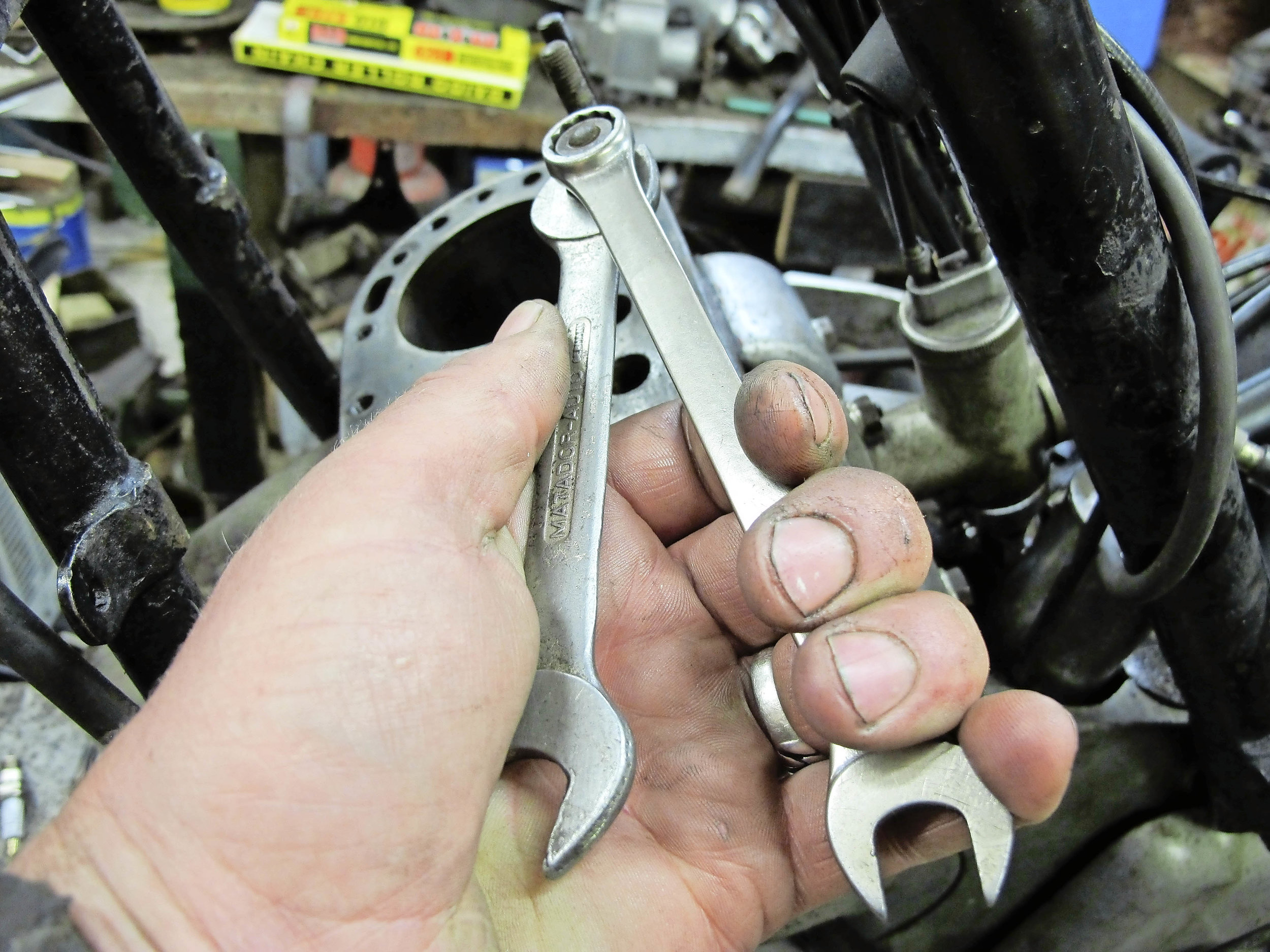 4.  Unwind with spanner on bottom nut or, better still, hold two spanners like pliers, to keep up the jam effect.