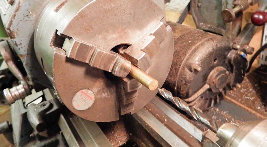 1.  Drill a hole into the end of a bar; the diameter needs to be the across-flats measurement of the square head.