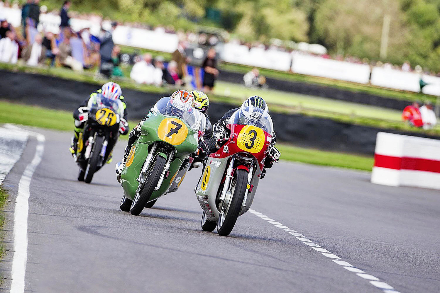 McWilliams gets his head down in pursuit of Dunlop at the Goodwood Revival