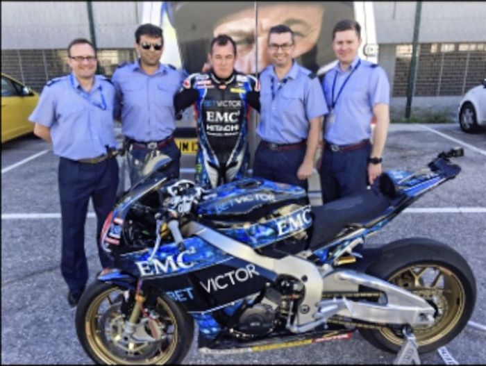 RAF+guys+move+in+for+a+cuddle+with+John+McGuinness.jpg