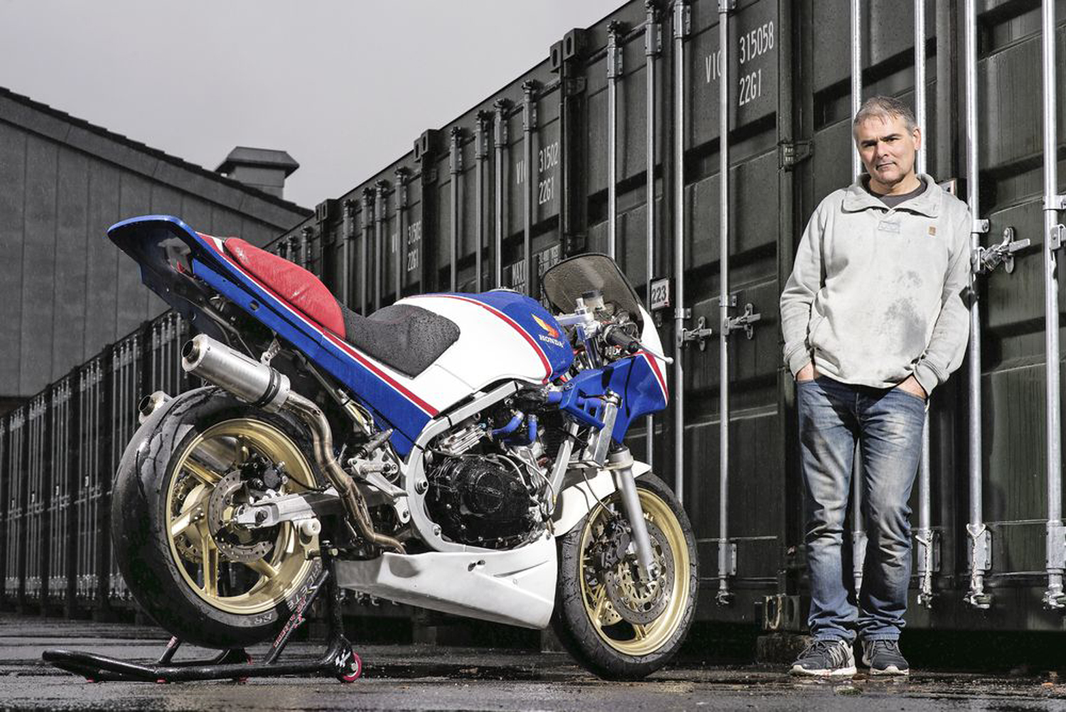 He can hardly contain himself. No wonder. Very nice bike