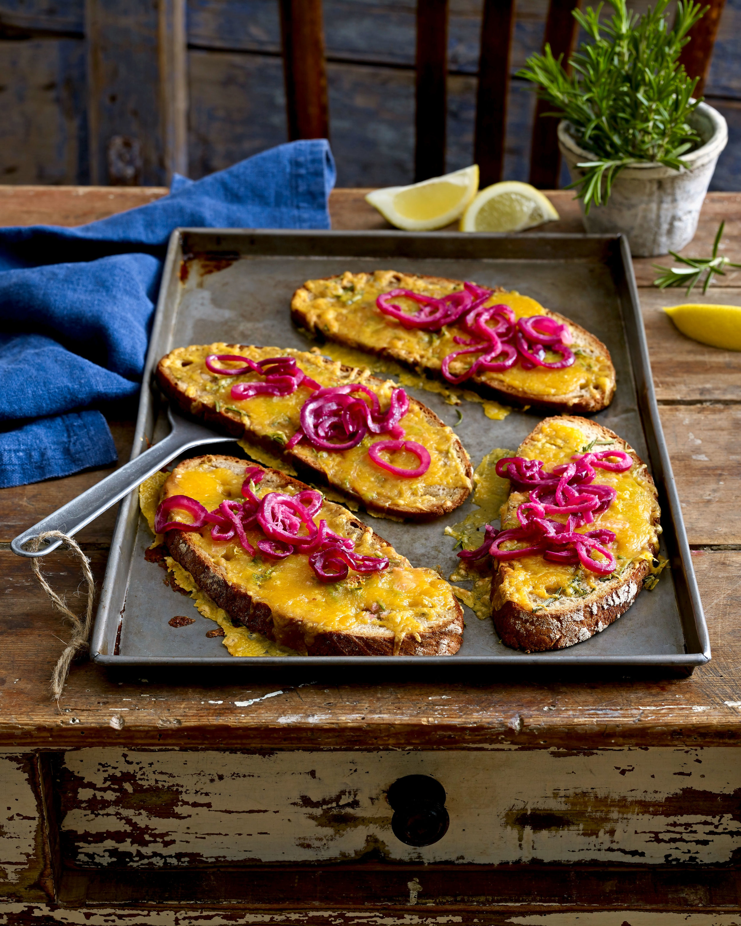 Crumbly Lancashire cheese topped with sweet and tangy red onions. A quick and tasty lunch pairing on toast. From a recipe in the September 2018 issue of Land Scape .