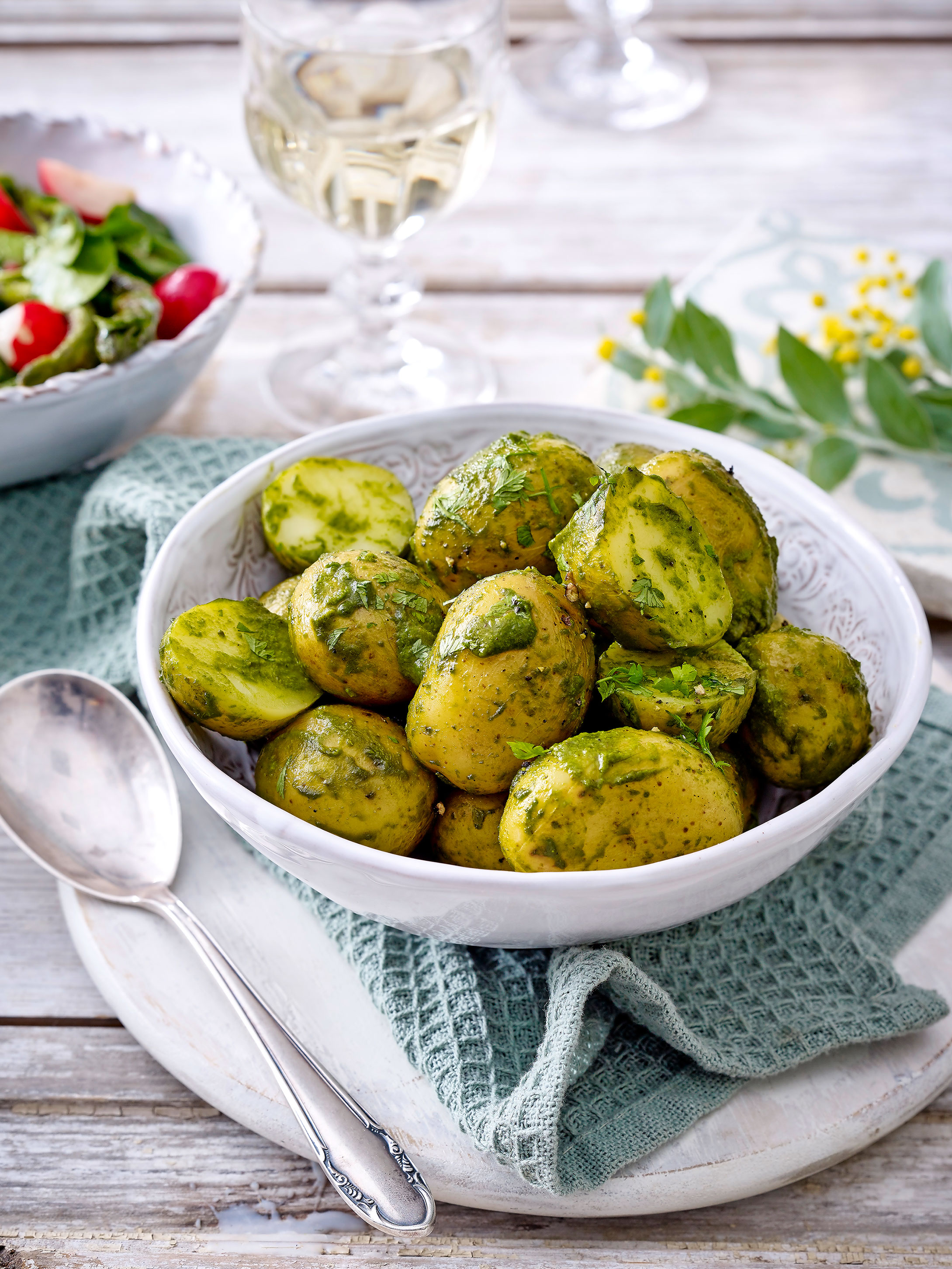 New potatoes tossed in wild garlic and olive oil. Simple and delicious.