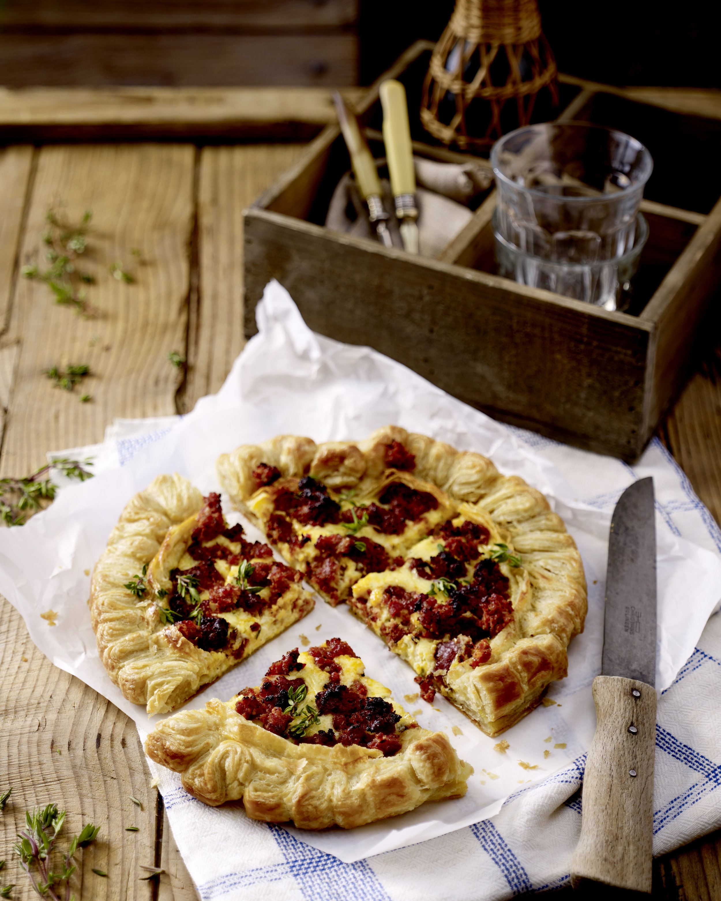 Golden pastry topped with succulent sausage meat in this delicious tart makes a tasty supper dish.