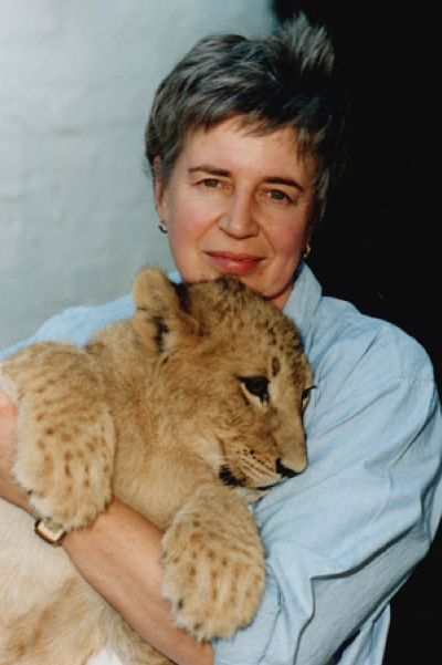 Gill Parker with lion cub whilst on sarfari in South Africa