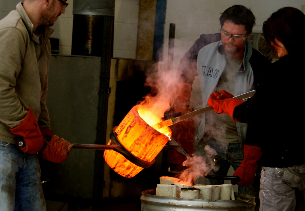 Preparing for the molten metal to be poured into the moulds during the casting process