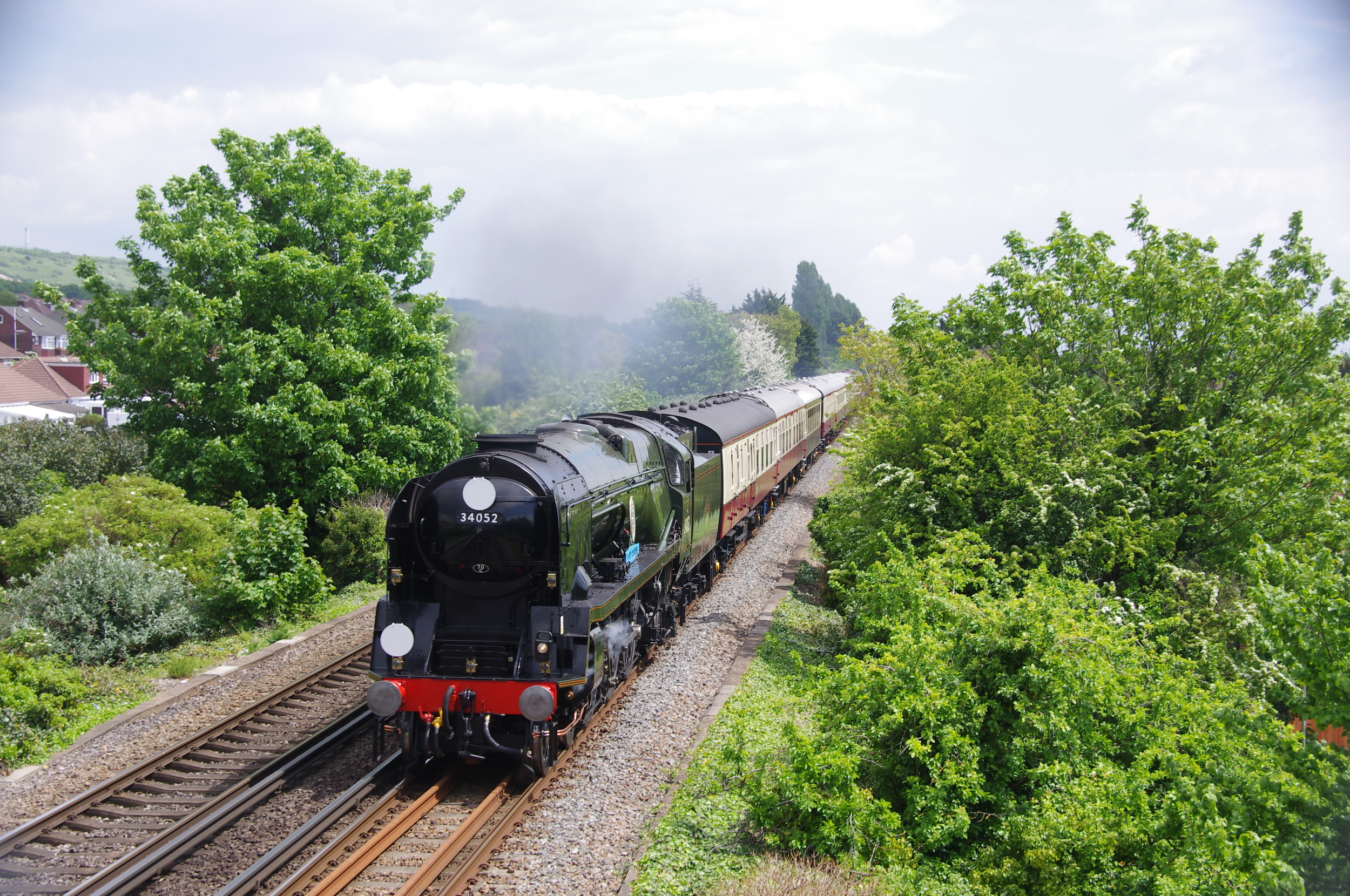 'West Country' No. 34046  Braunton, posing as 'Battle of Britain' No. 34052  Lord Dowding, approaches Portchester with the Clapham-Southampton football special on May 15. Credit: Mervyn Turvey