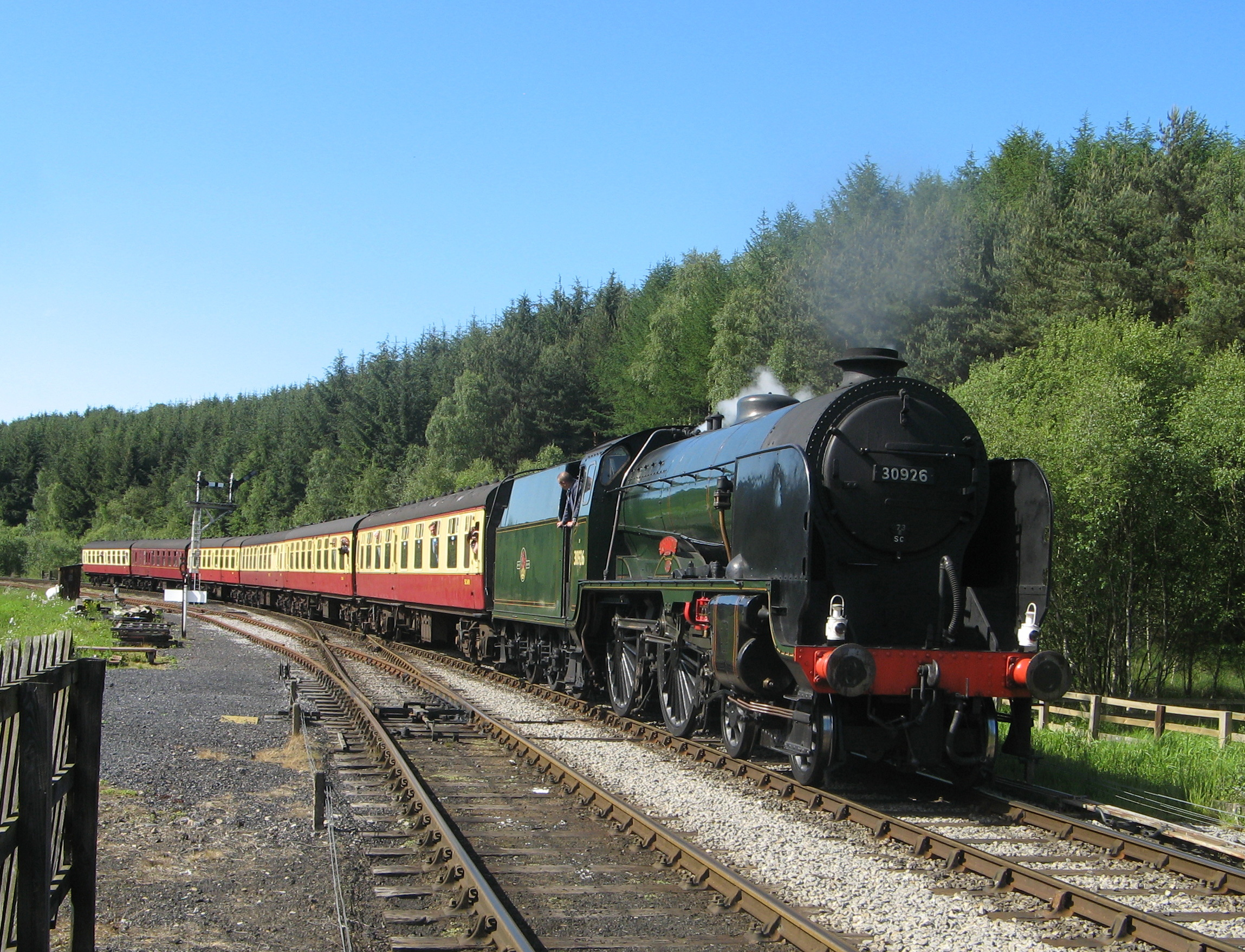 'Schools' No. 30926  Repton  will be making a welcome return visit to the Severn Valley Railway at the line's 'Autumn Steam Gala' on September 21-21. It is pictured here steaming into Levisham at its North Yorkshire Moors Railway home. PHILIP BENHAM