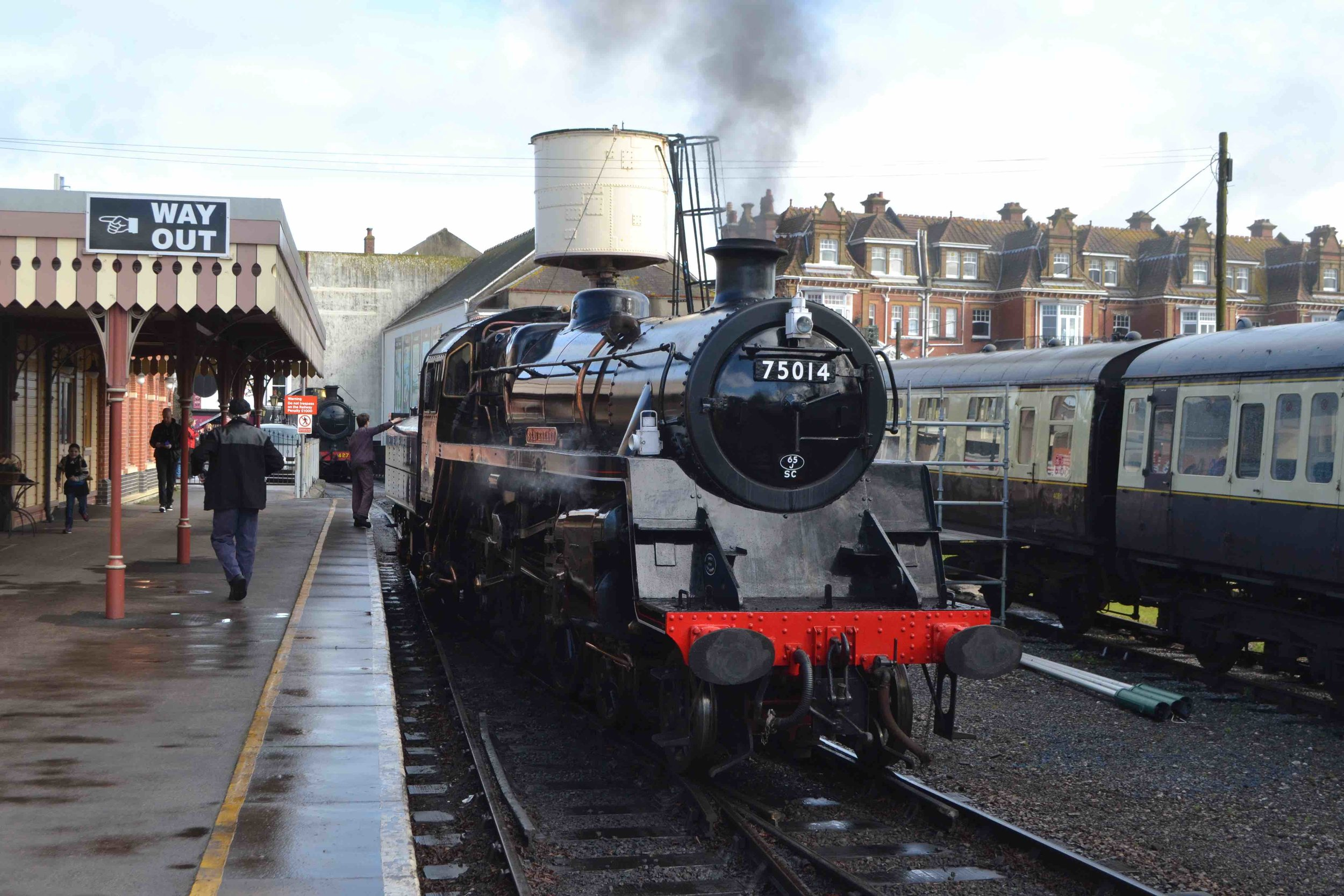 BR Standard '4MT' No. 75014, star of the West Somerset Railway's forthcoming 'Autumn Steam Gala' on October 5-8, leaves Paignton during its official re-launch into traffic on March 22. TOBY JENNINGS/SR