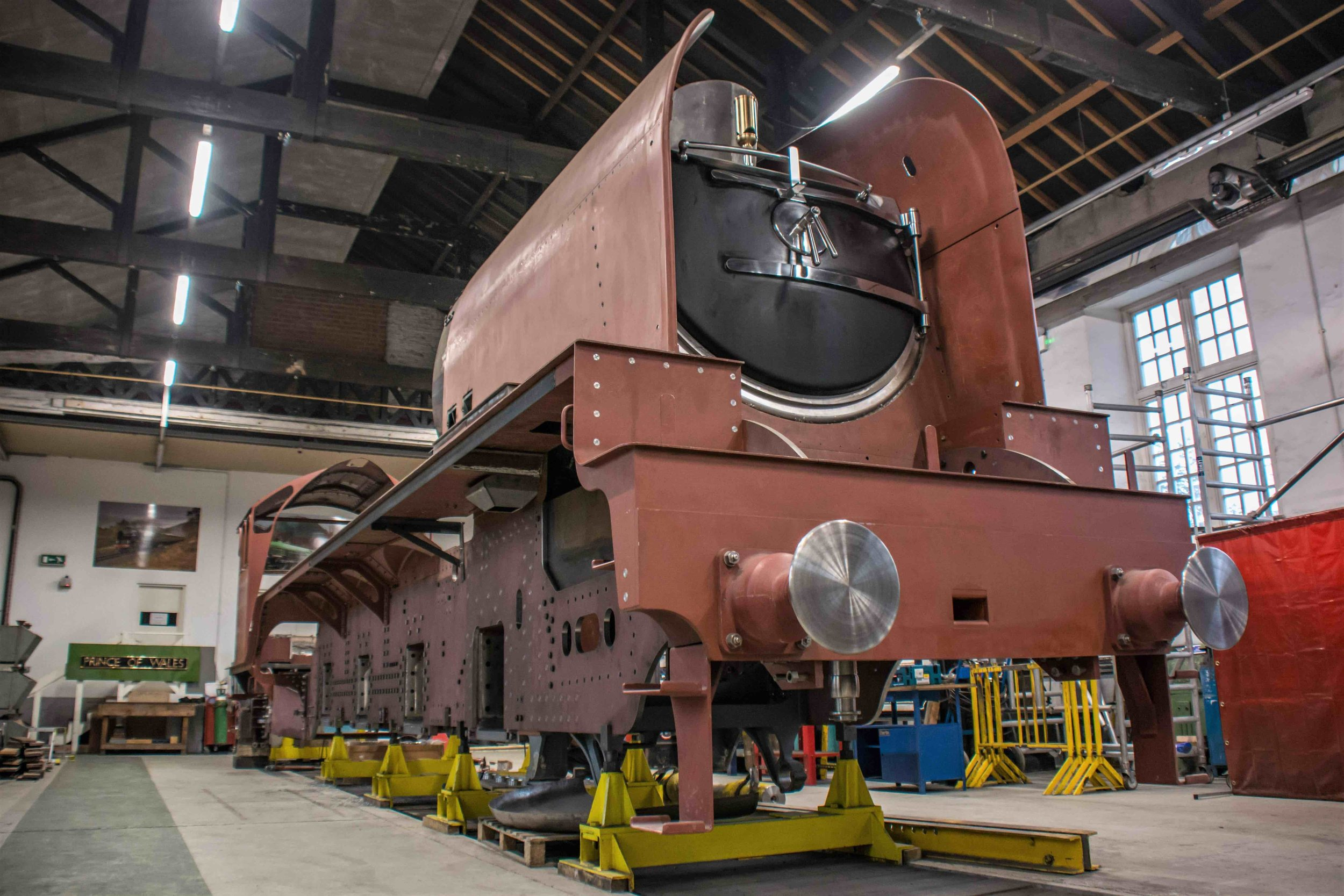 The imposing shape of the new-build 'P2' No. 2007  Prince of Wales  – ready to receive its crank axle and wheels – inside Darlington Locomotive Works. MANDY GRANT