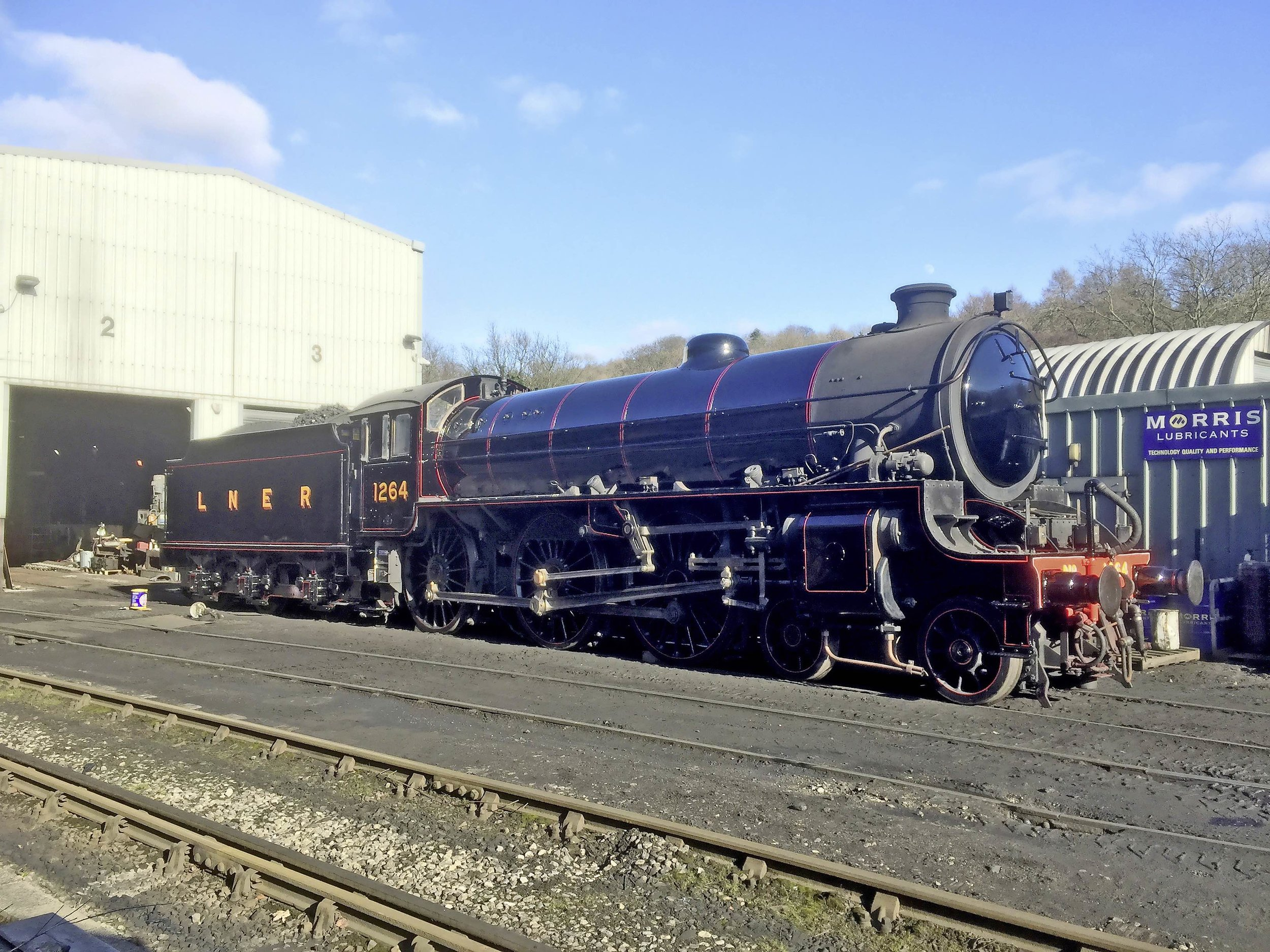 Outshopped in LNER lined black for the first time, 'B1' No. 1264 glistens in the sun outside Grosmont shed, on the North Yorkshire Moors Railway. MARK O'BRIEN