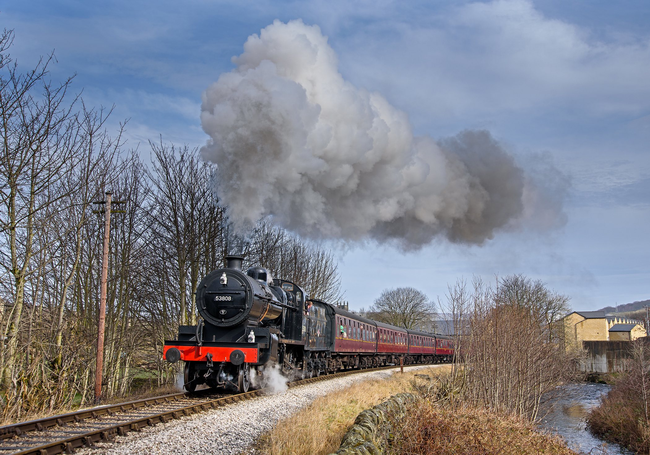 Destined for the Severn Valley Railway's 'Spring Steam Gala' on March 16-18, '7F' No. 53808 – the eleventh-hour replacement for 'B1' No. 1264 – leaves Ingrow West on March 11 at the Keighley & Worth Valley Railway's recent spring gala. KARL HEATH