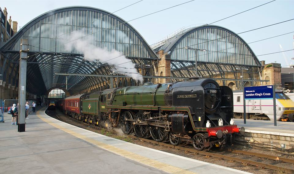 Destined for the Gloucestershire Warwickshire Steam Railway's 'Cotswold Festival of Steam', 'Britannia' No. 70013  Oliver Cromwell  prepares to depart Kings Cross. NICK BRODRICK/SR