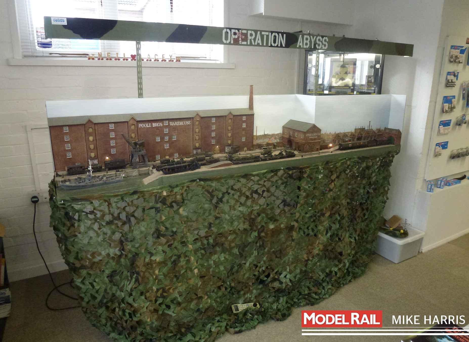Camouflage netting hides the wooden trestles on which the layout stands. MIKE HARRIS