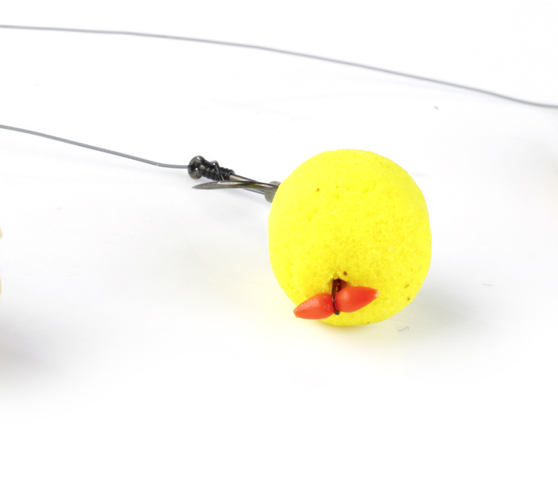A 10mm yellow dumbell wafter resembles a grain of corn and blends in well with the loose offerings. It has two key benefits over the corn – being so light it sinks very slowly through the water, increasing the chances of a carp seeing it and following it down.Then, once on the bottom, it becomes a very light hookbait that is easily sucked up by a feeding fish.
