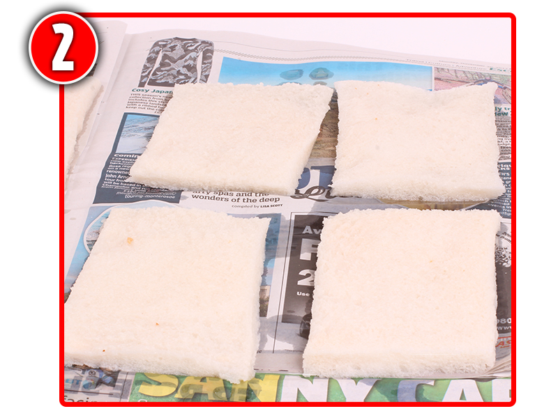 Lay the wetted slices of bread on a few sheets of newspaper.