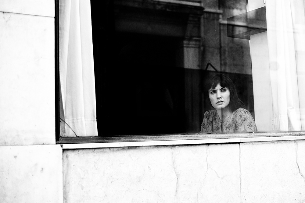 Craig-Reilly-Photography-Lisbon-bnw-portrait-through-window.jpeg