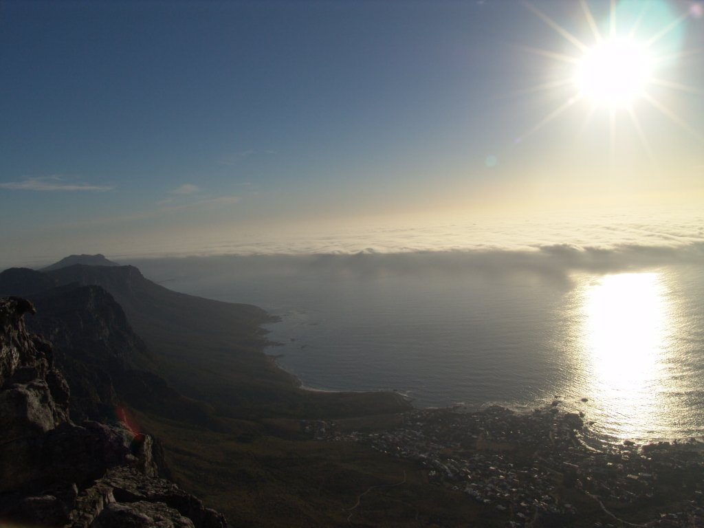 South-Africa-Cape-Town-Table-Mountain-views-at-top-low-cloud-blanket-rolling-into-the-bay-1-DHD.jpg