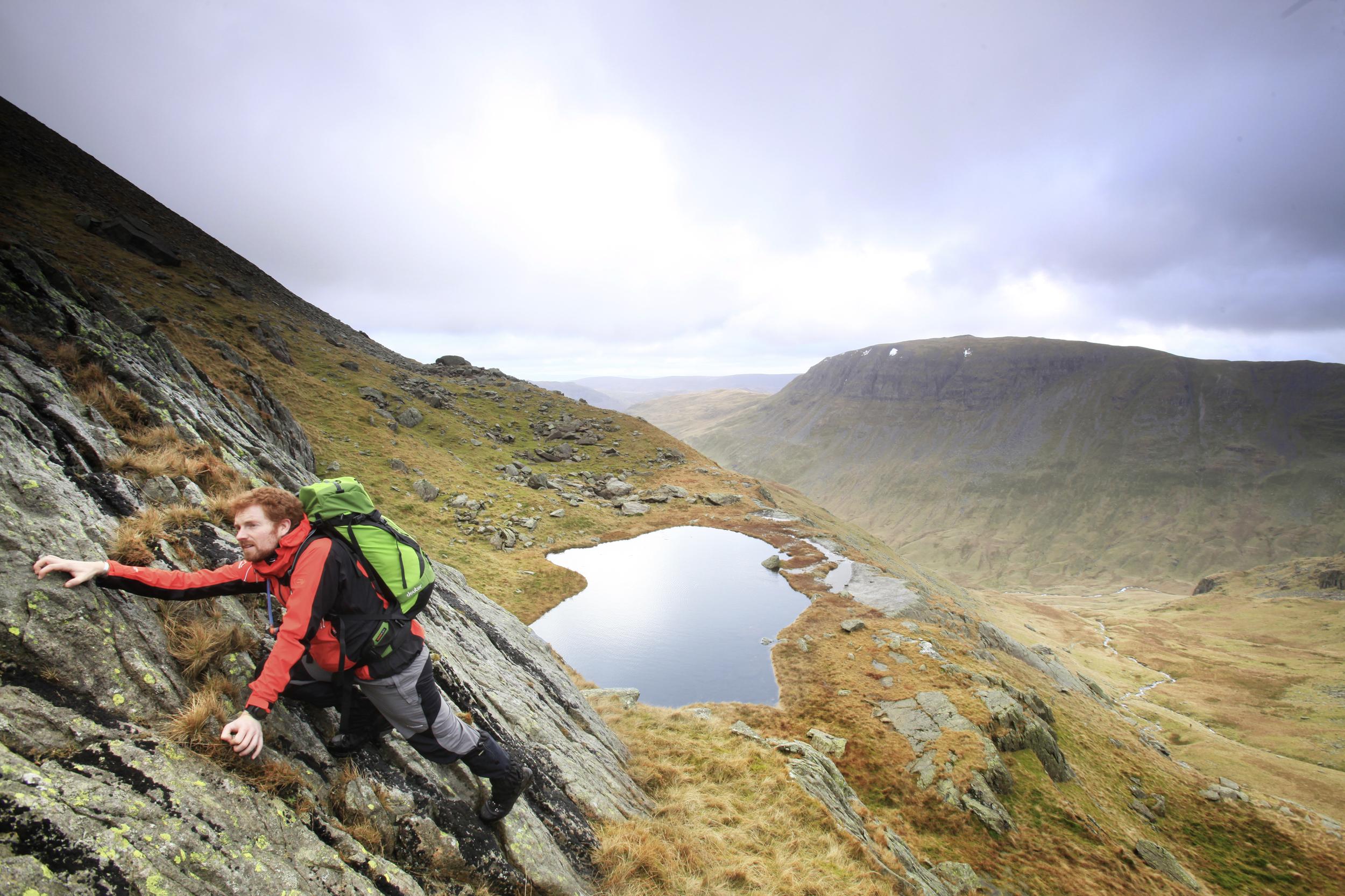 Scrambling hard above Hard Tarn.  Photo : Tom Bailey © Trail Magazine