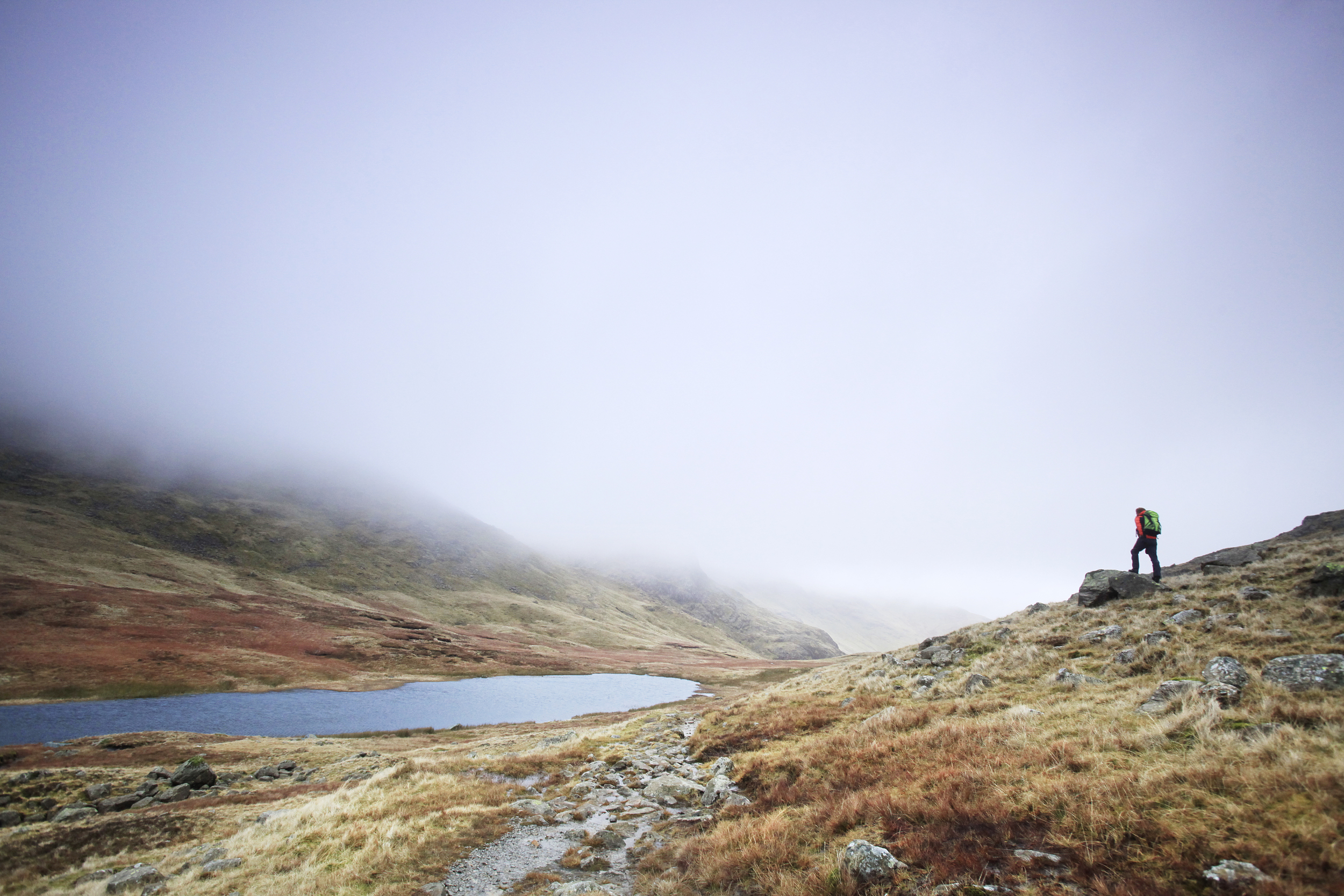Red Tarn, beneath Cold Pike.  Photo : Tom Bailey © Trail Magazine