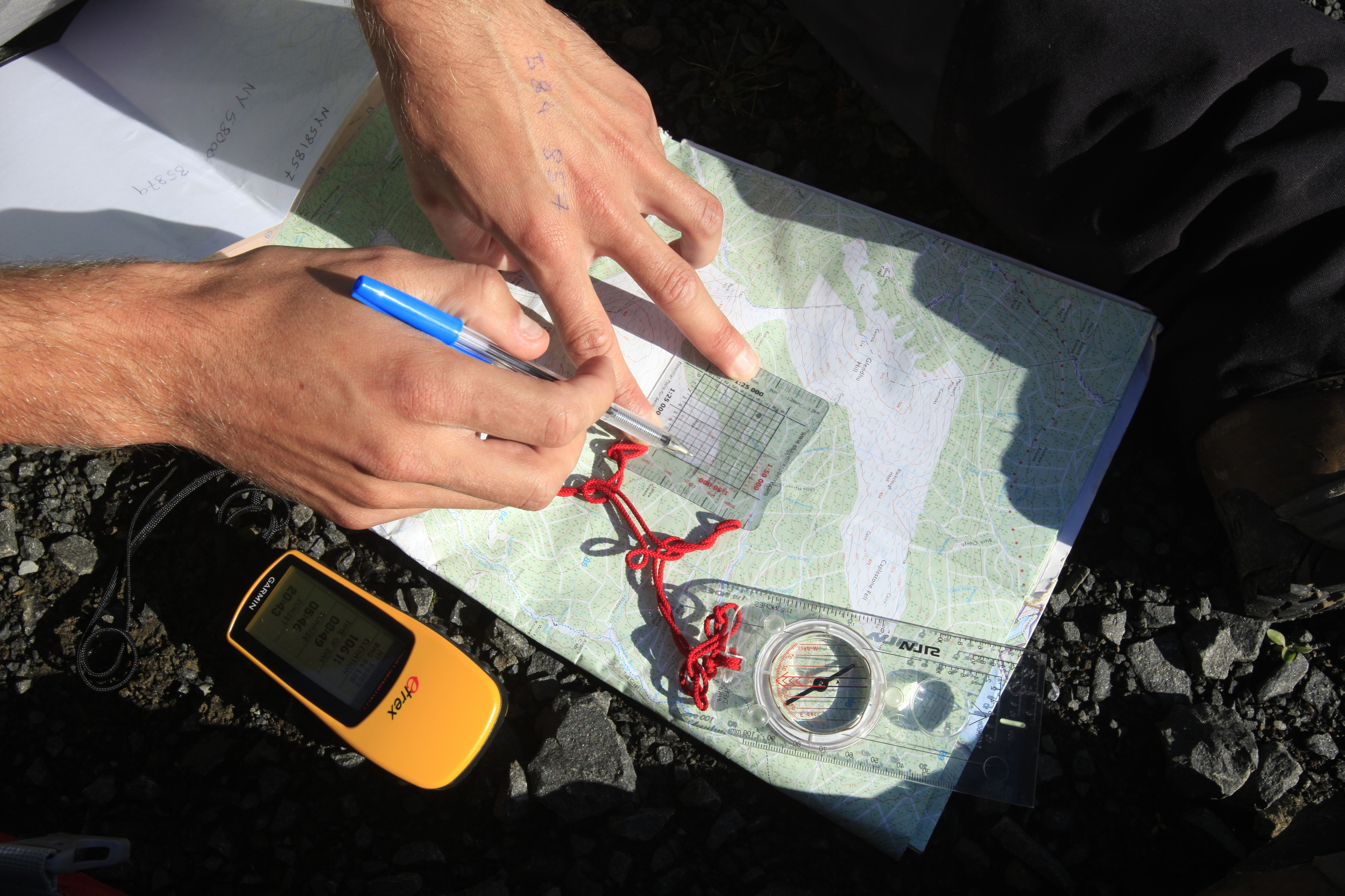 Working out exactly where you are can be a multi-media business...  Photo : Tom Bailey © Trail Magazine