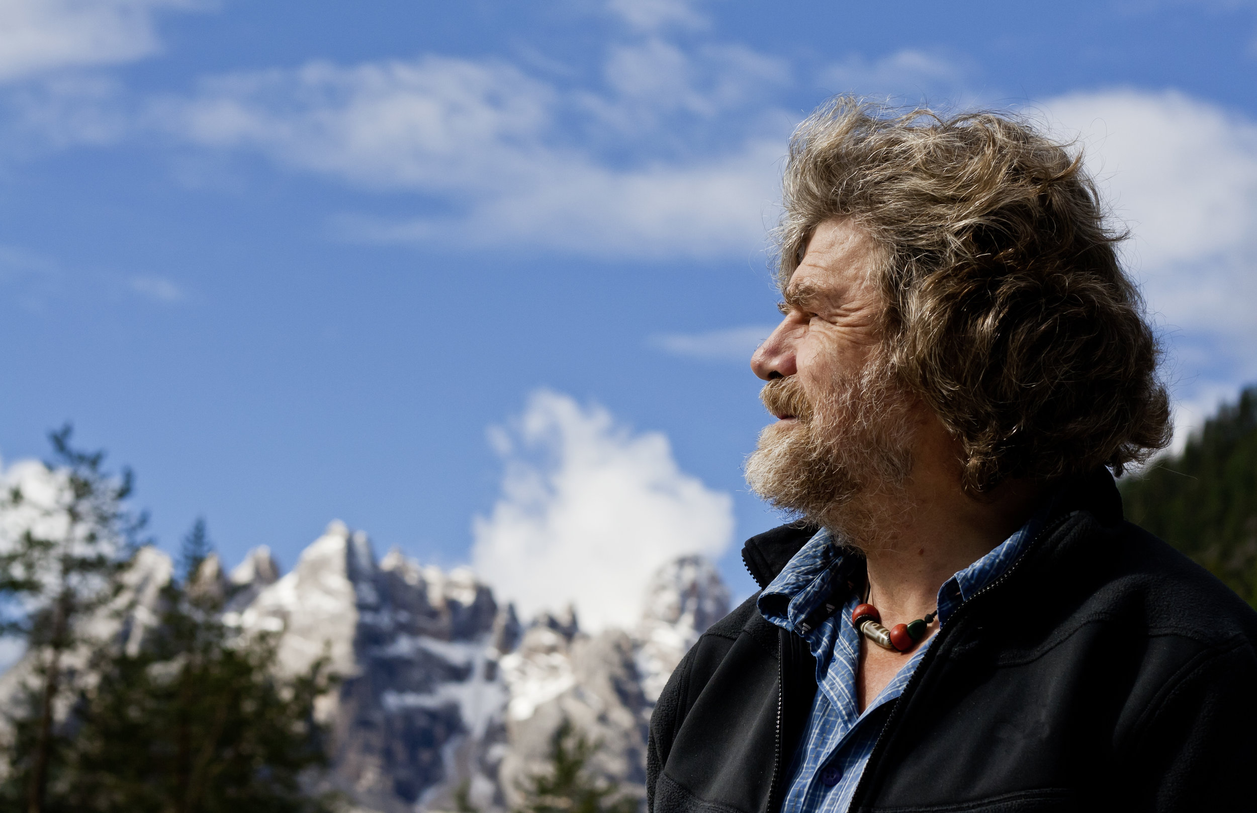 """""""The game climbers play is simple – we go freely to a place where you could die, to not die."""" Messner in the Dolomites.  Photo : Simon Ingram / Trail Magazine"""