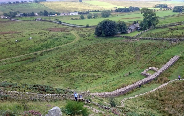 A section of Hadrian's Wall near Twice Brewed. The inn can be seen in the upper left of the photo.