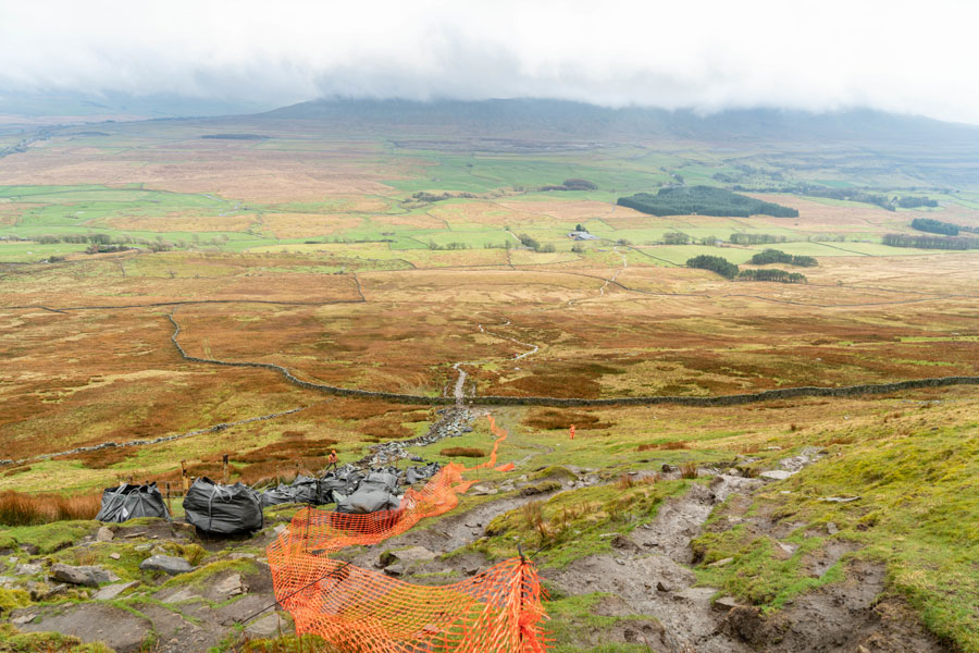 Stone deposit by the helicopter beside the deteriorated path. Photo: Andy Kay / YDNPA