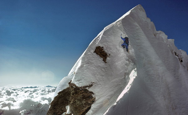 Dougal Haston on the Hillary Step during the first British ascent of Everest, 24 September 1975 – a massive contrast to 2019. Photo © Doug Scott