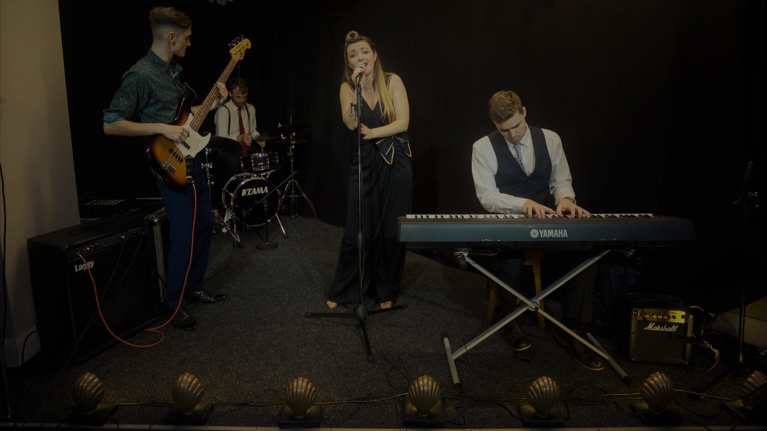 Nicola Anne with Band.jpg