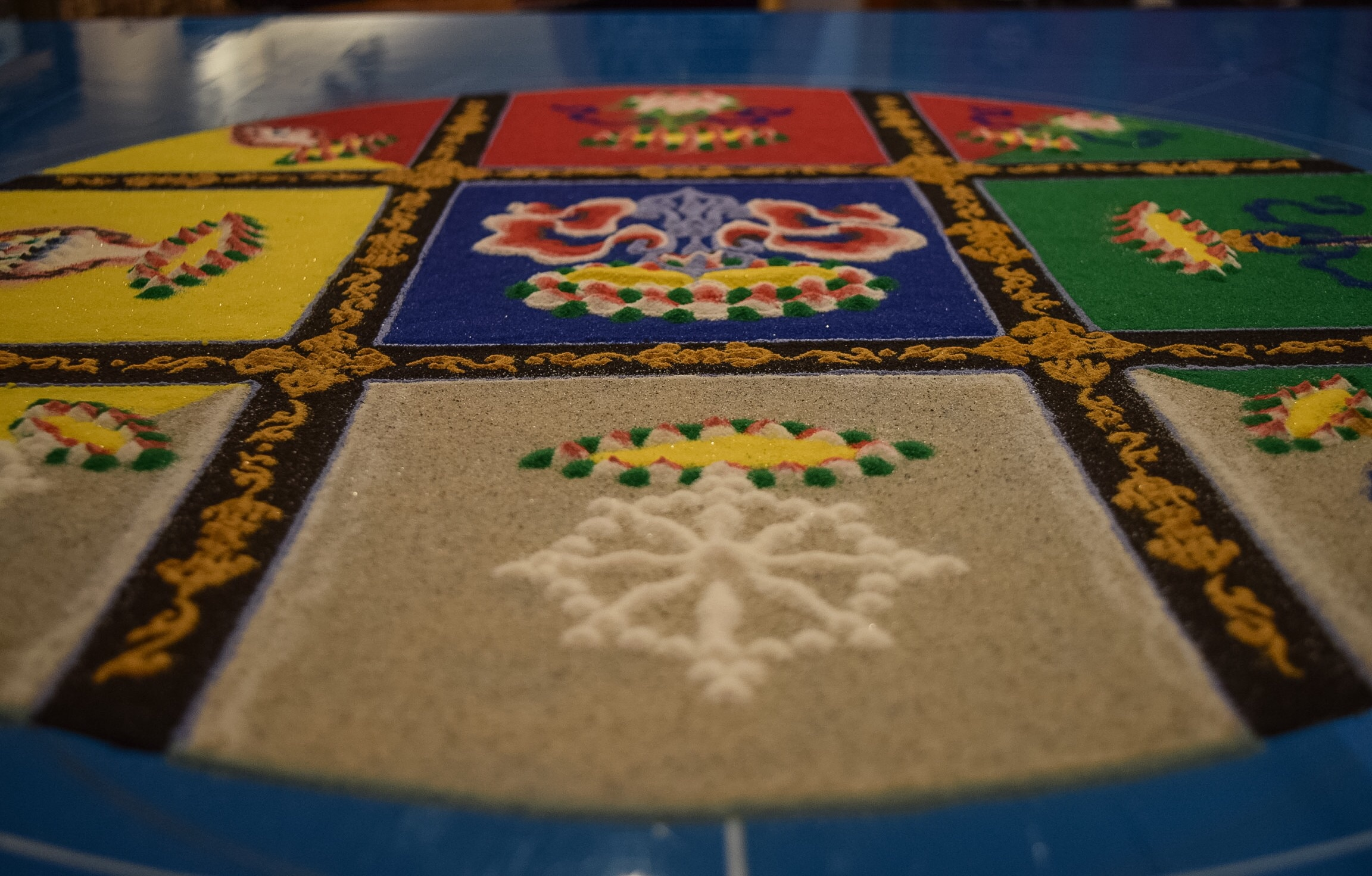 The sand mandala is a Tibetan Buddhist tradition involving the creation and subsequent destruction of mandalas to symbolize the transitory nature of material life.