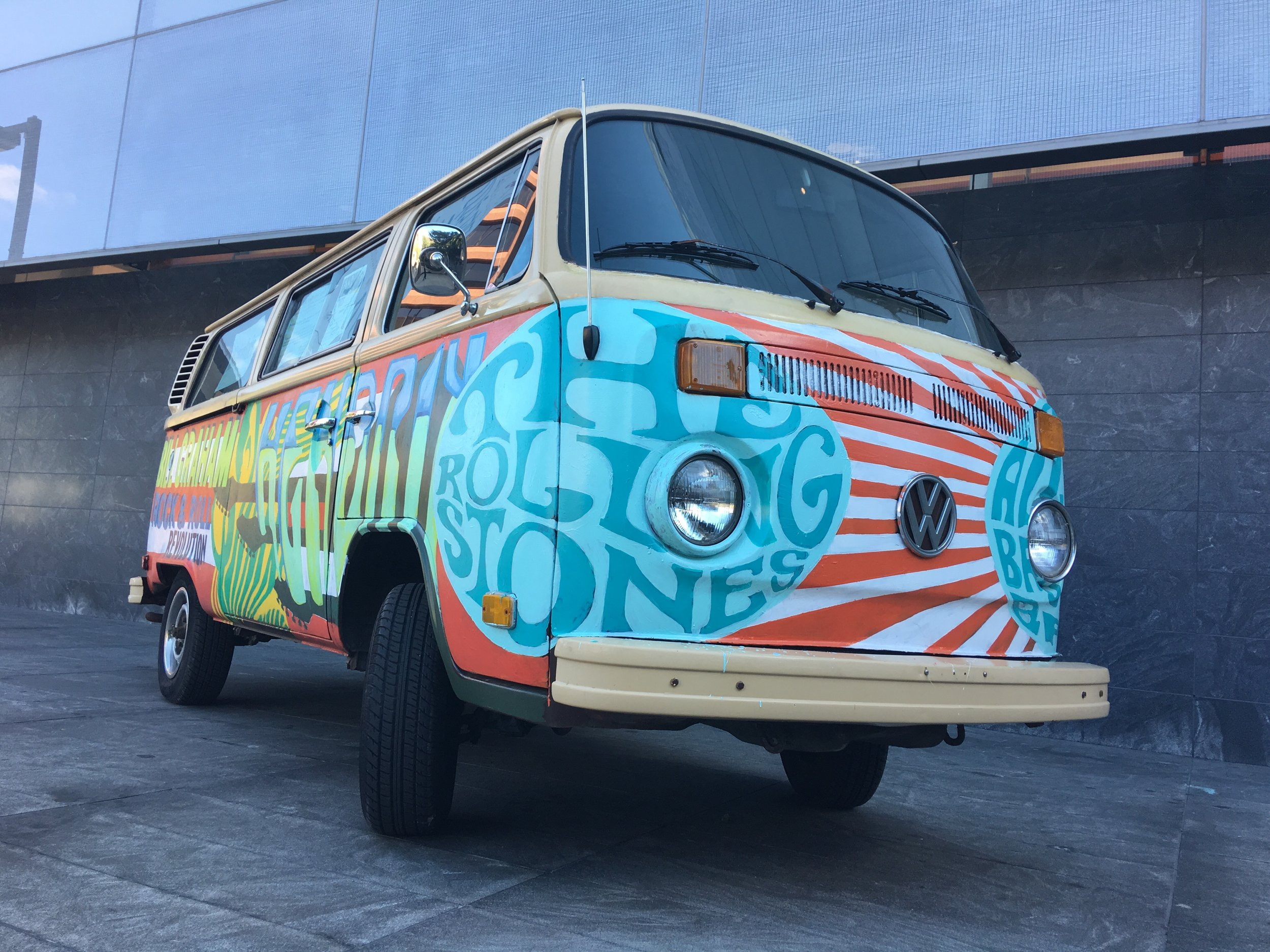 Hand-painted VW bus announcing the Bill Graham: Rock & Roll Revolution exhibit.