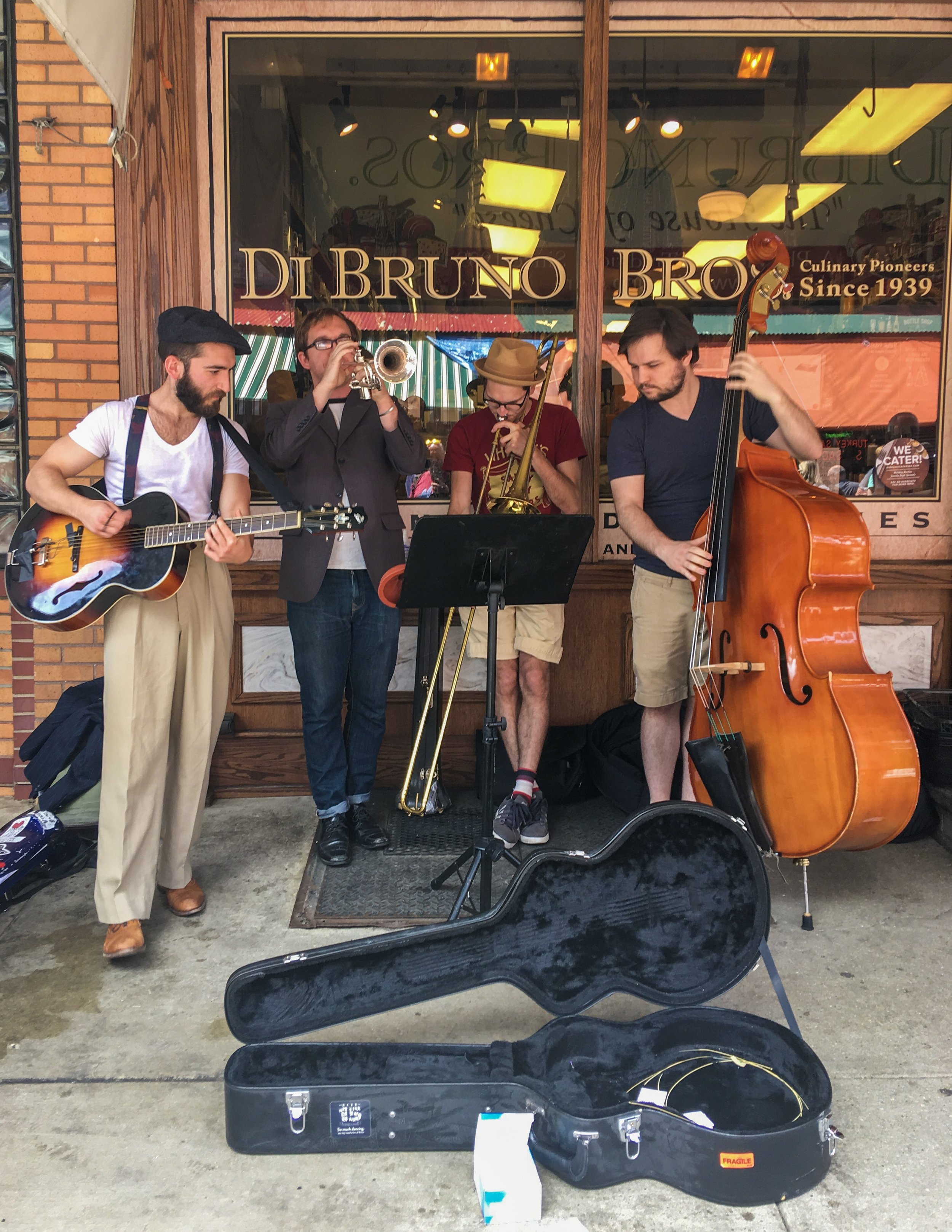 Buskers outside of DiBruno Brothers