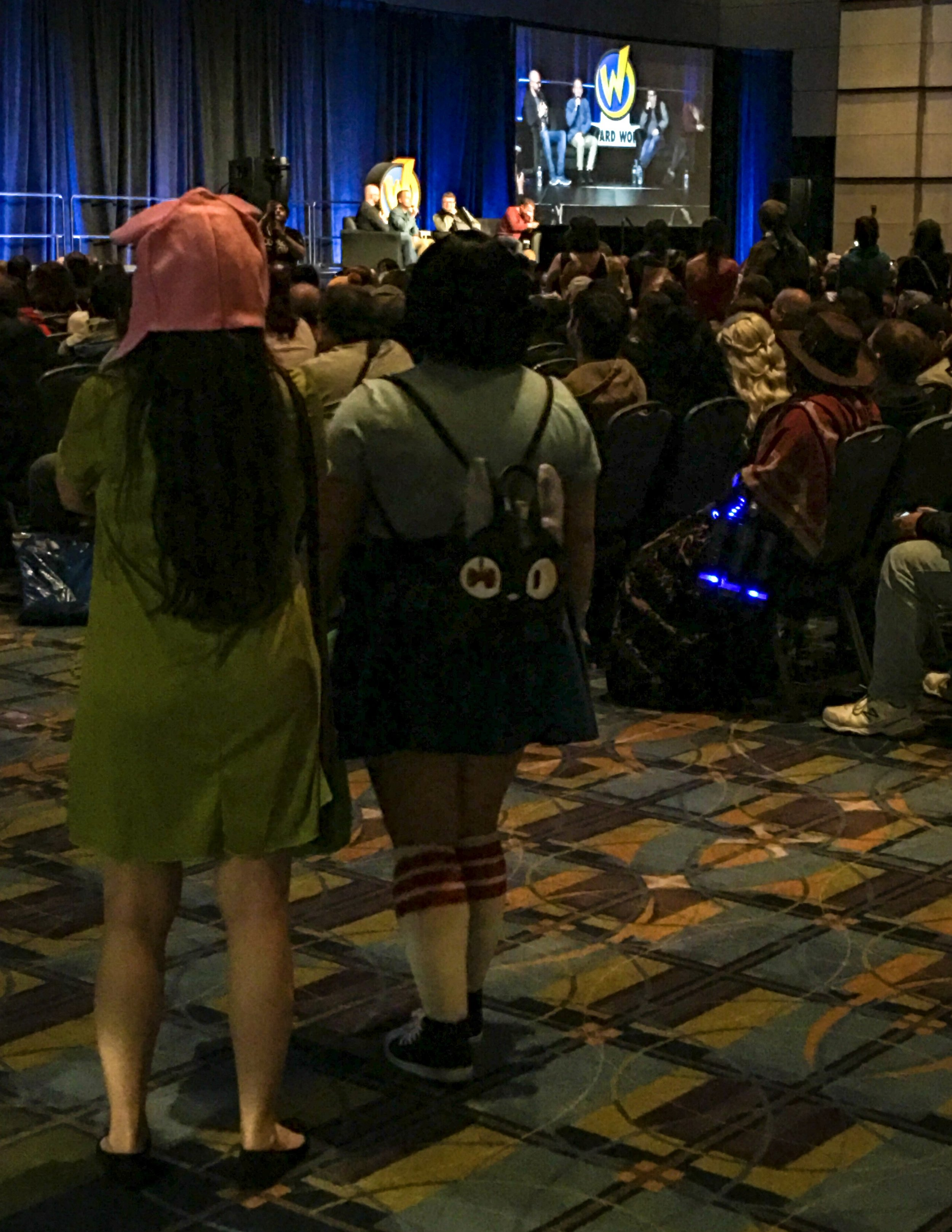 The nerd multiverse: Louise and Tina Belcher watch the panel discussion with Sean Astin, Elijah Wood, and Billy Boyd from The Lord of the Rings.
