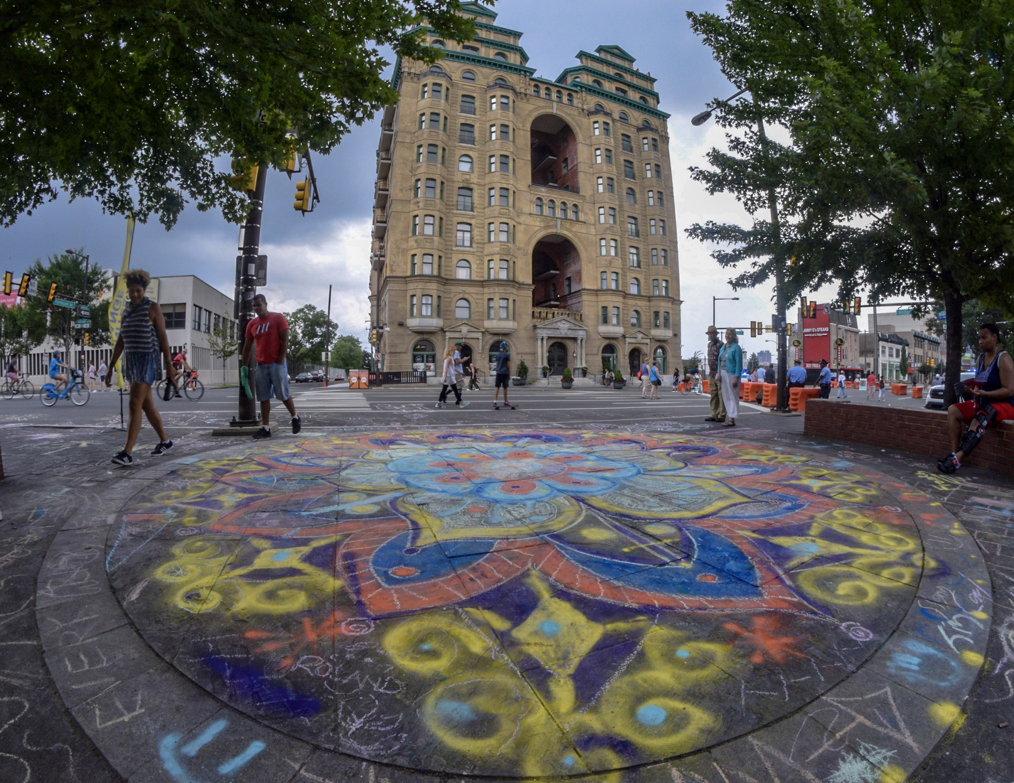 A chalk Peace mandala across the street from the Divine Lorraine.