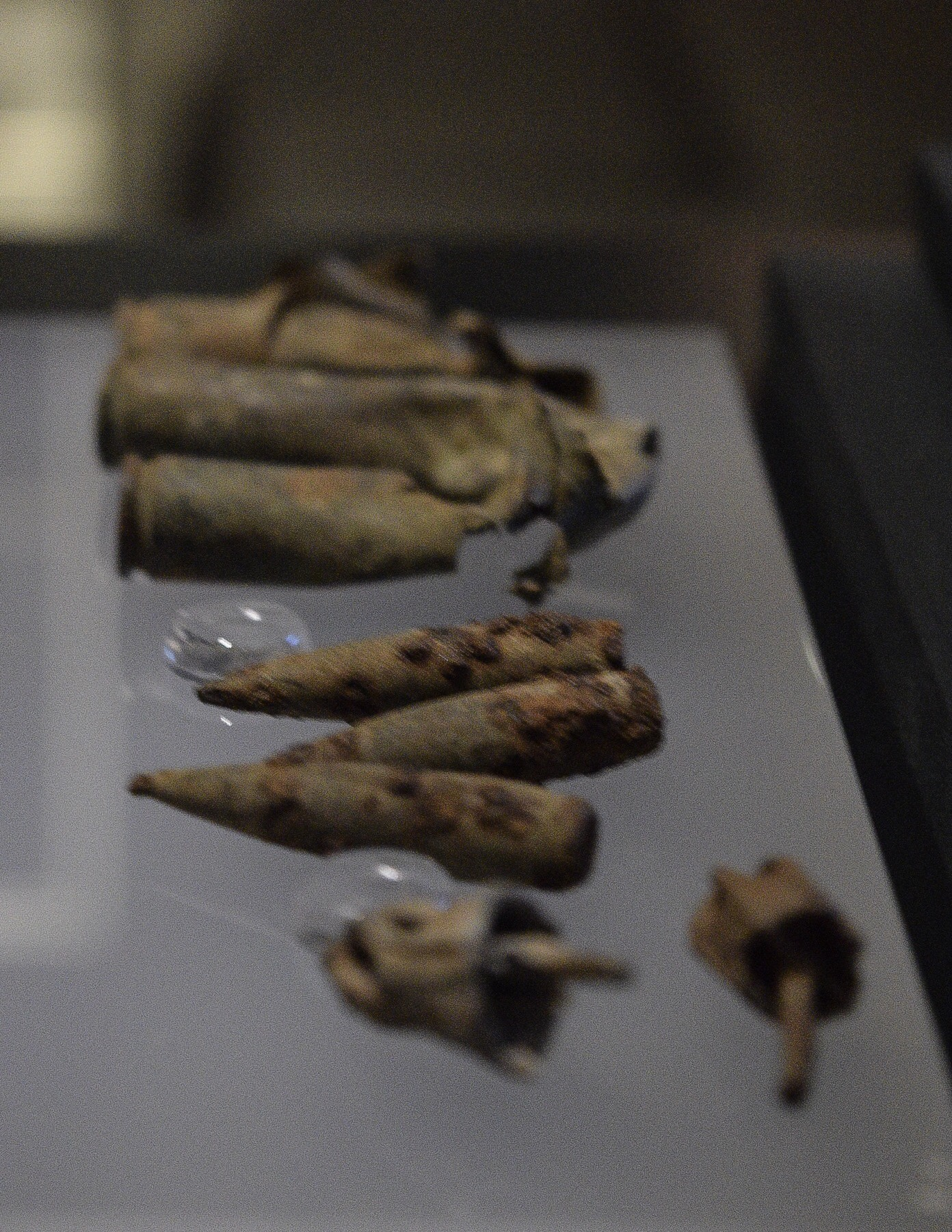 Handmade dreidels and bullets, found in one of the camp's mass graves