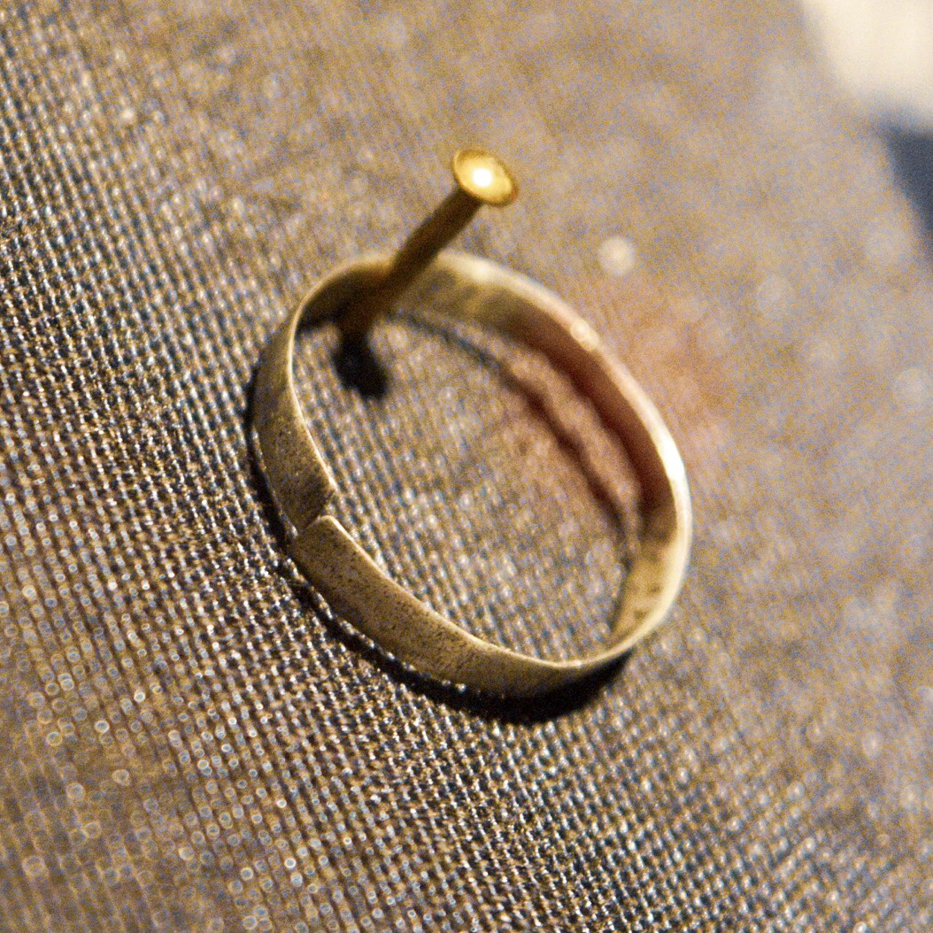 Handmade tin engagement ring made in the Thereisenstadt ghetto before both were deported to camps. She and this ring survived; he did not.