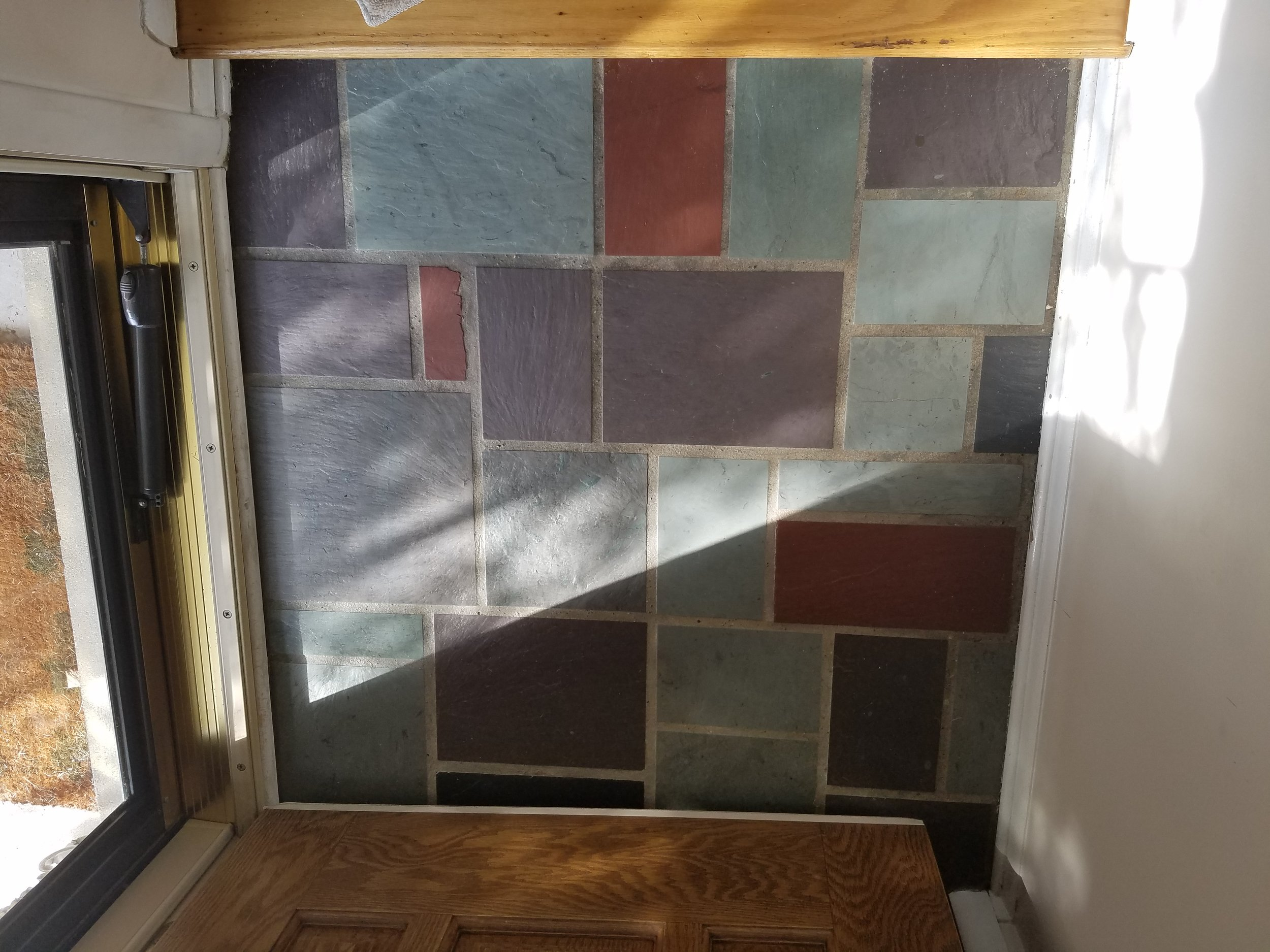 Years of wear have made the grout become faded and stained.