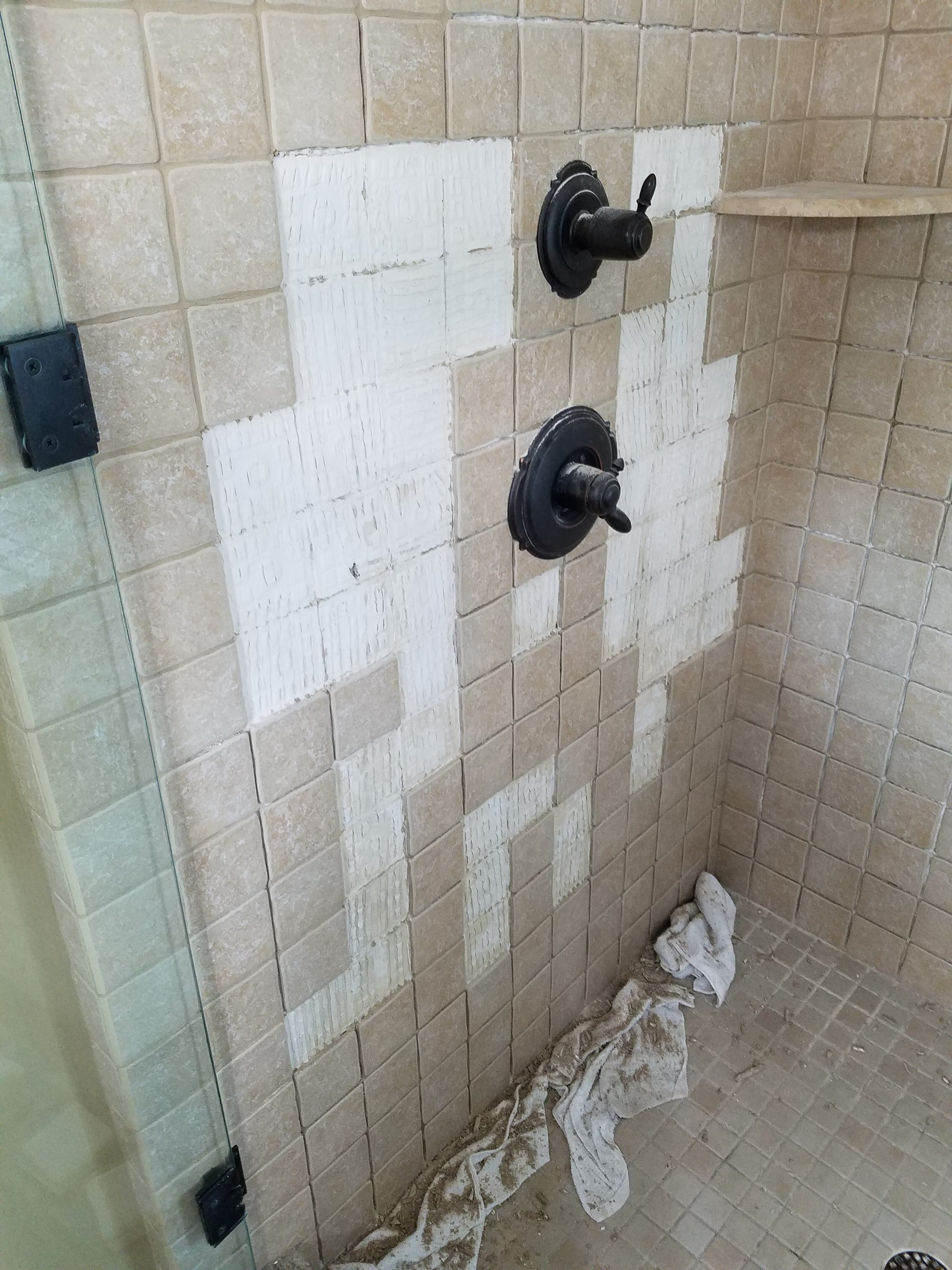 Loose tiles have come off during a regrout.