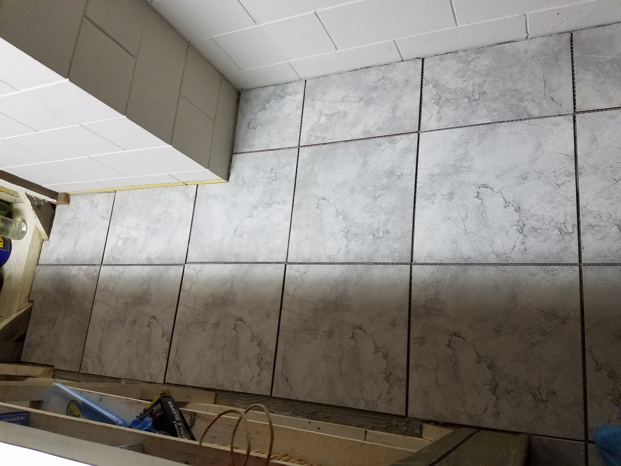 Tiles waiting to be grouted behind a new bar installation.
