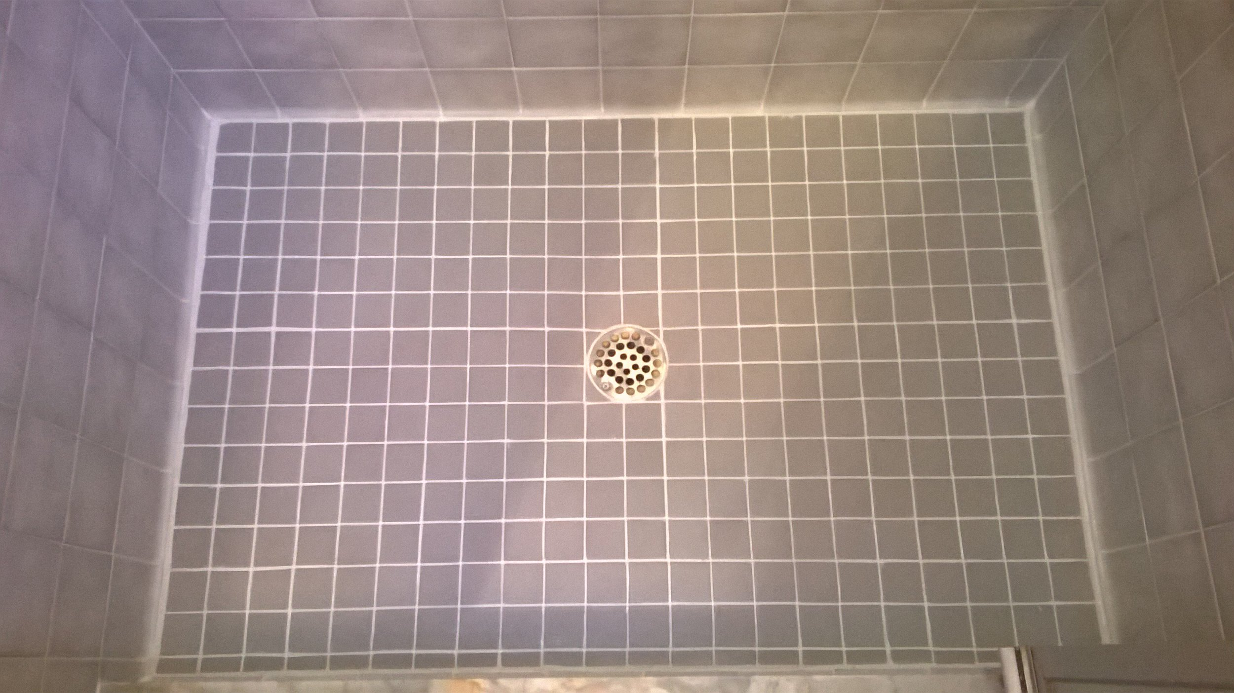 Master shower floor after cleaning and sealing of tile and grout