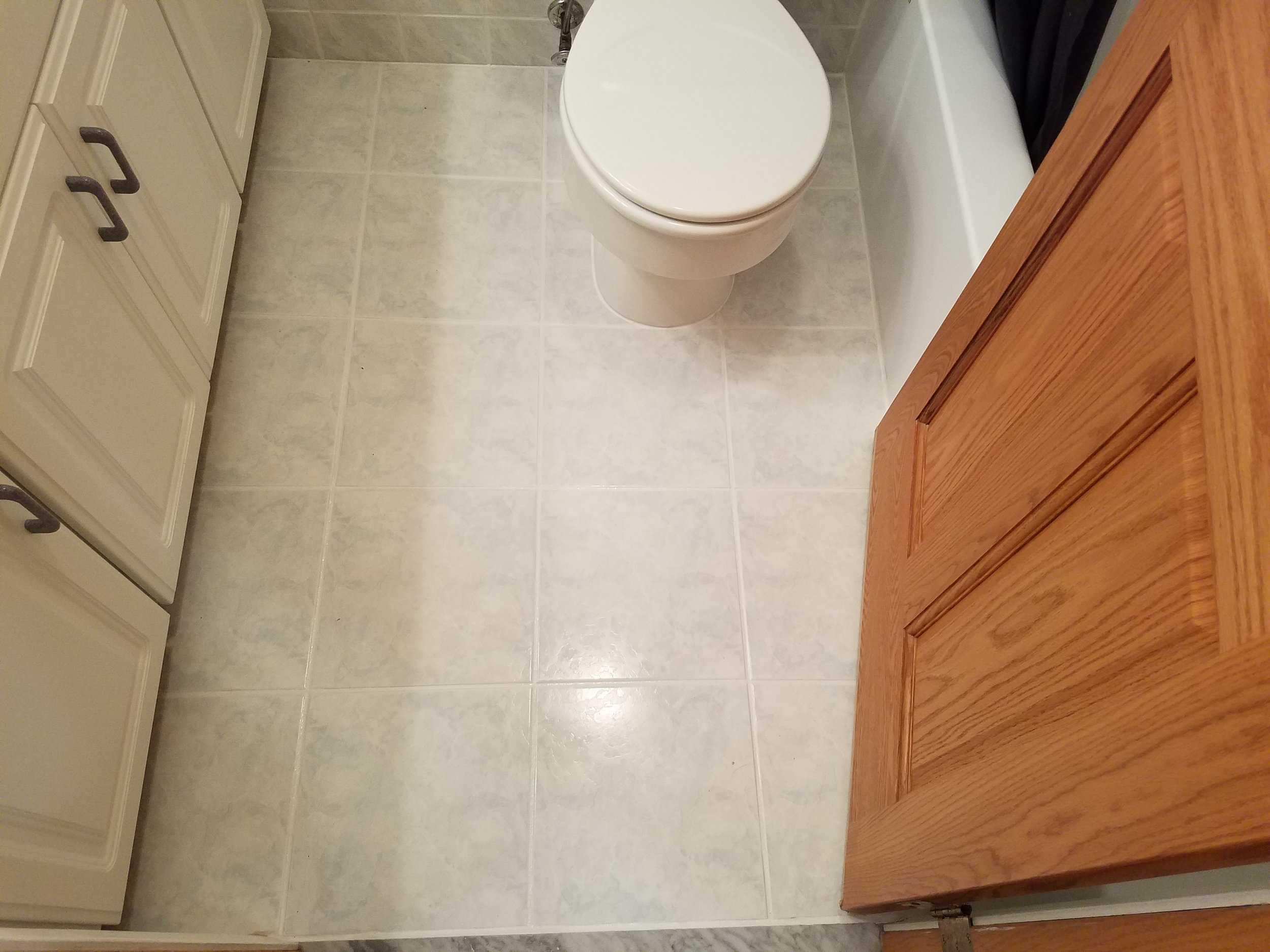 bathroom floor tile and grout cleaned and sealed