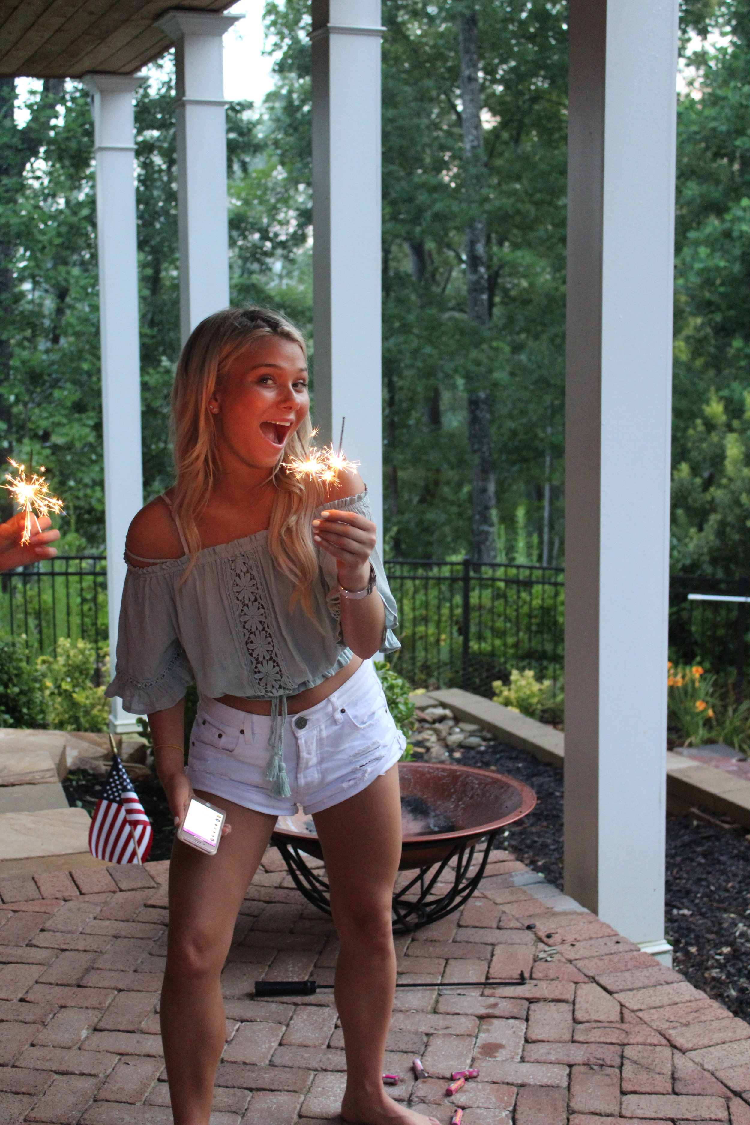 Avery charming the camera with her sparklers