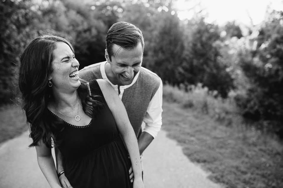couple standing on park path smiling and laughing  - stouffville lifestyle photos