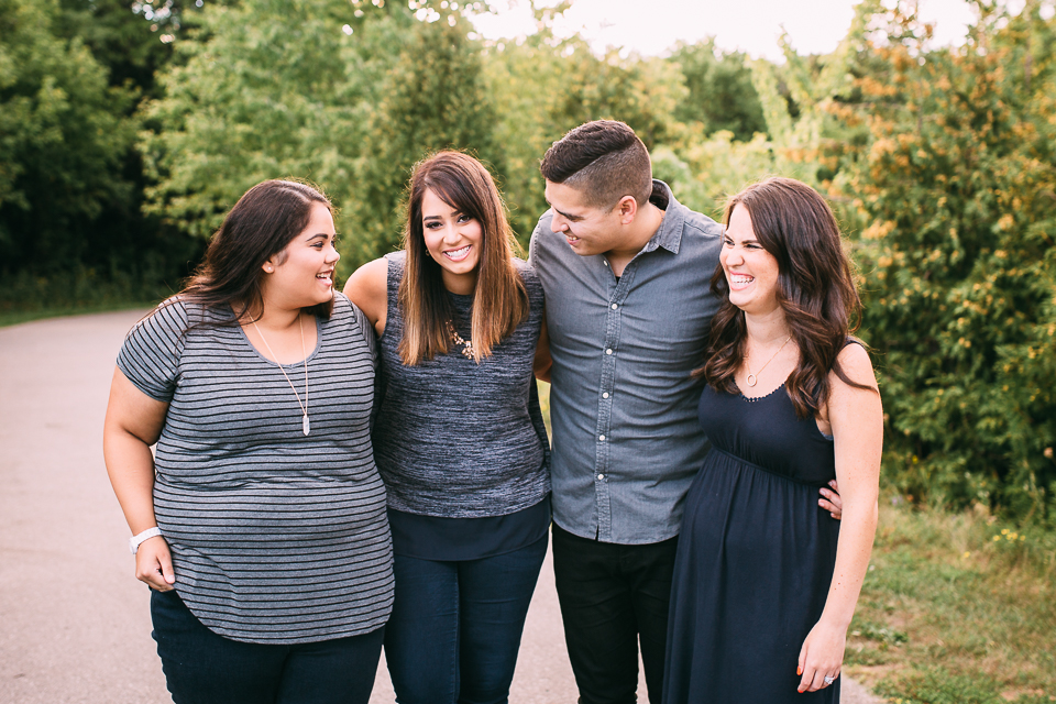 4 adult siblings laughing together in park - Stouffville lifestyle photography