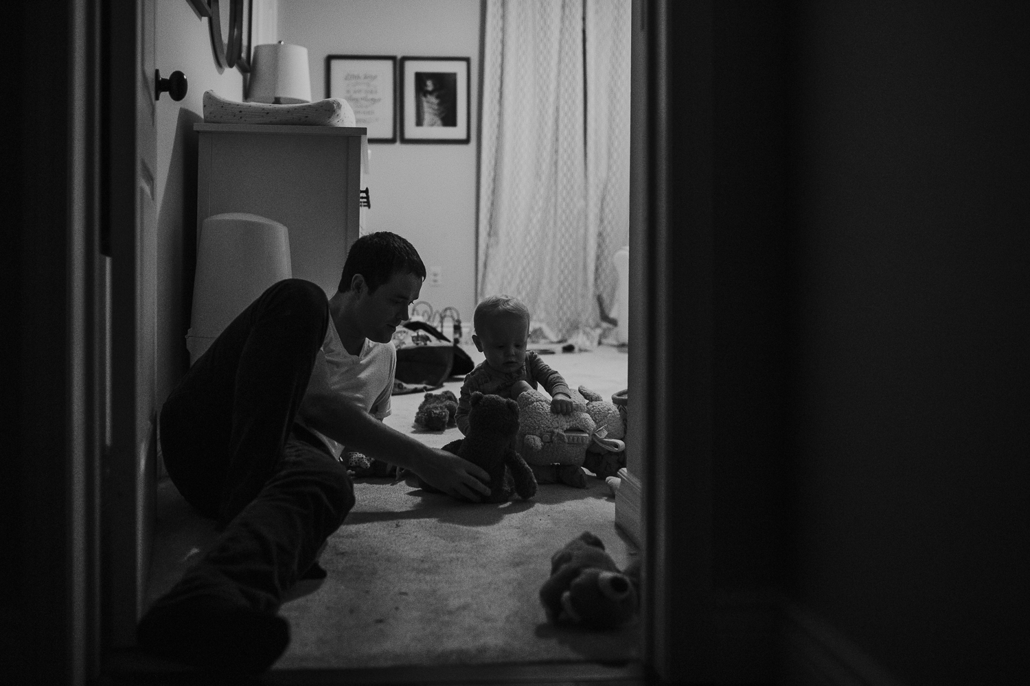 Father and 1 year old baby boy playing in bedroom at night - York Region documentary photography