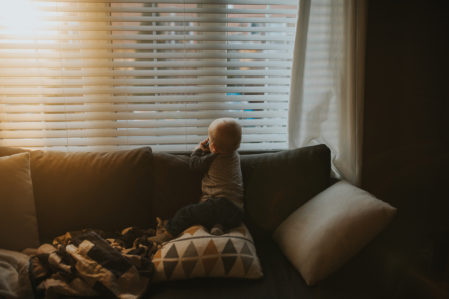 1 year old baby boy looking out window at sunset - Uxbridge child photograp