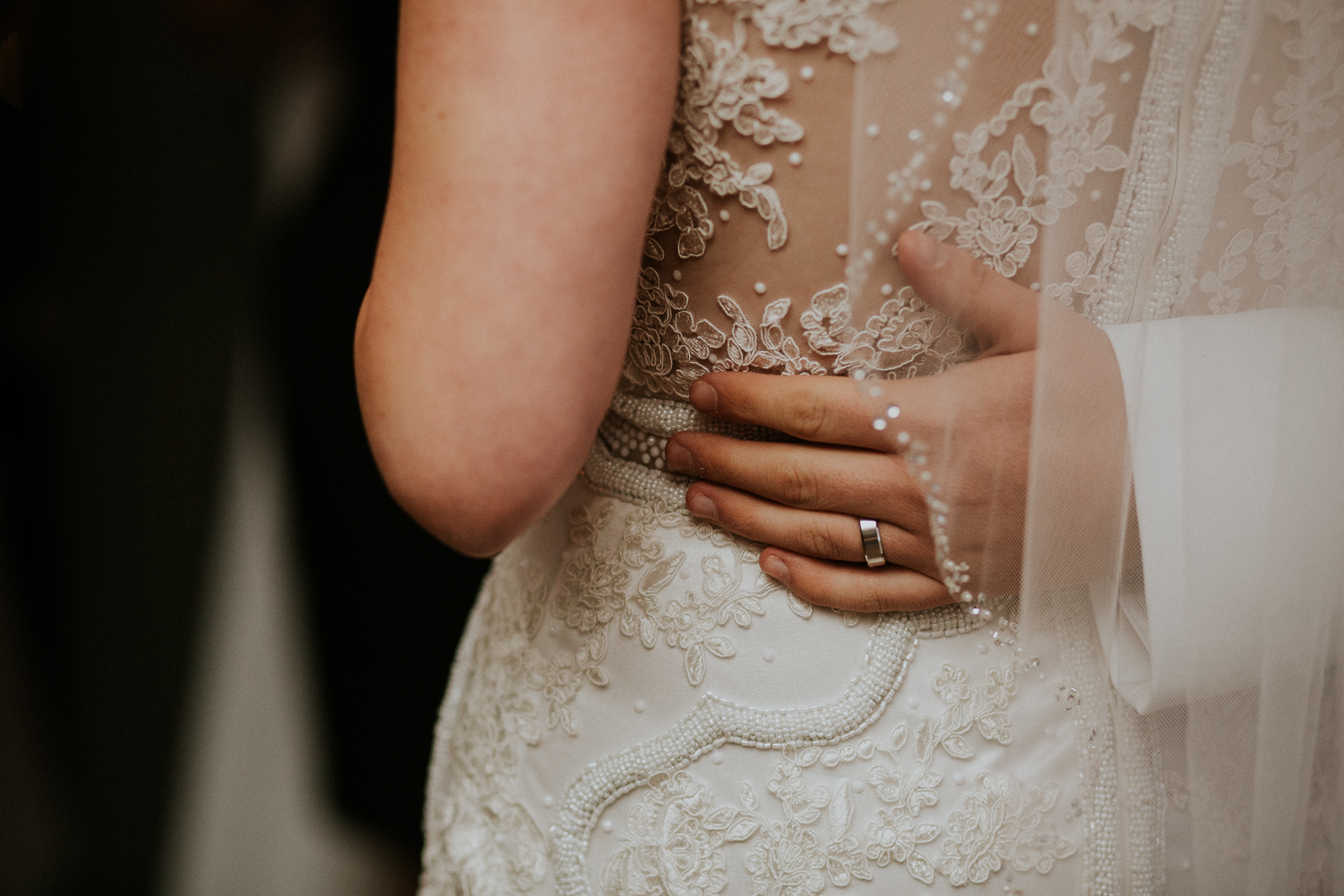 groom's hand with wedding ring on bride's waist - Newmarket photography