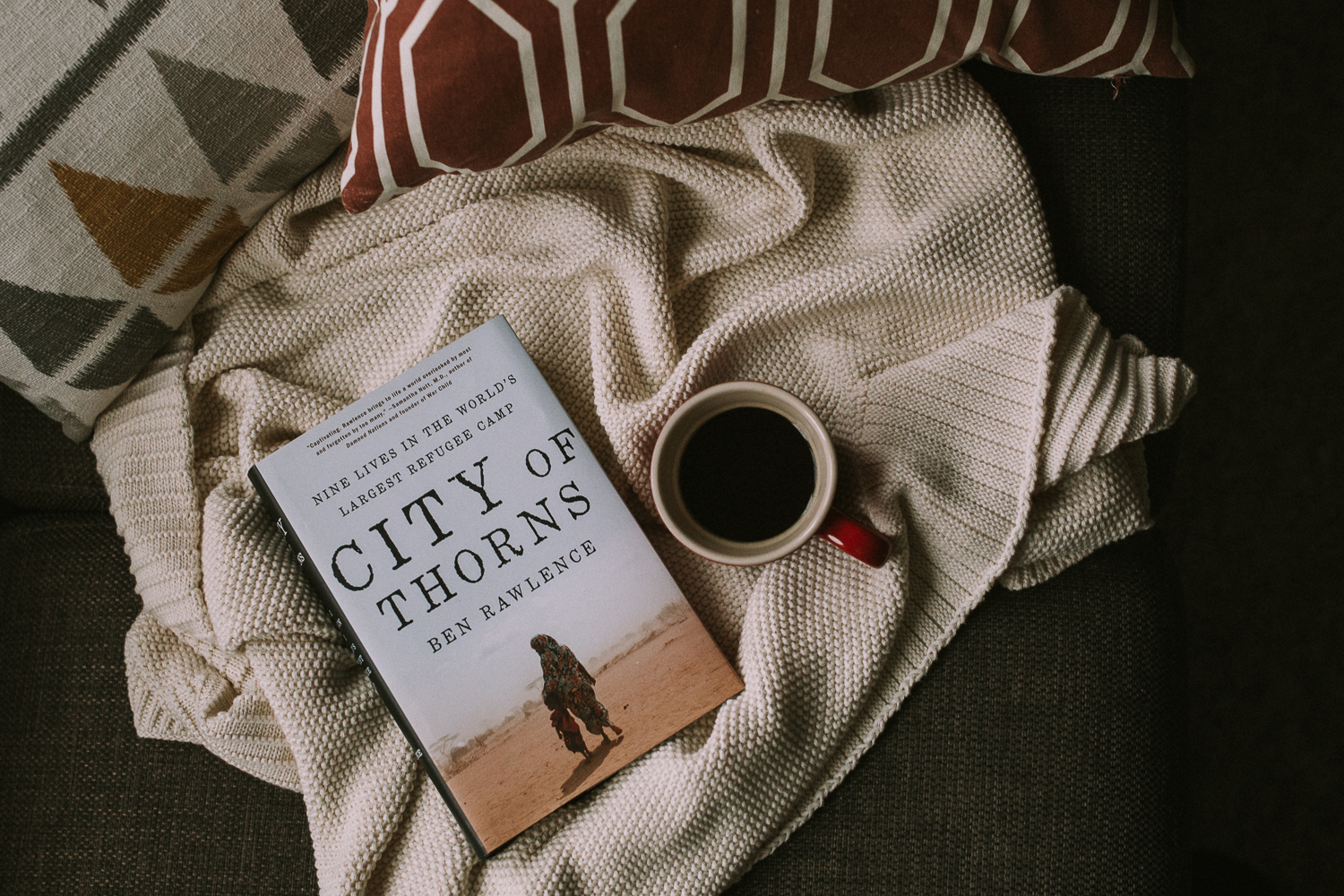 photo of book on cream knit blanket with mug of coffee - markham lifestyle photo